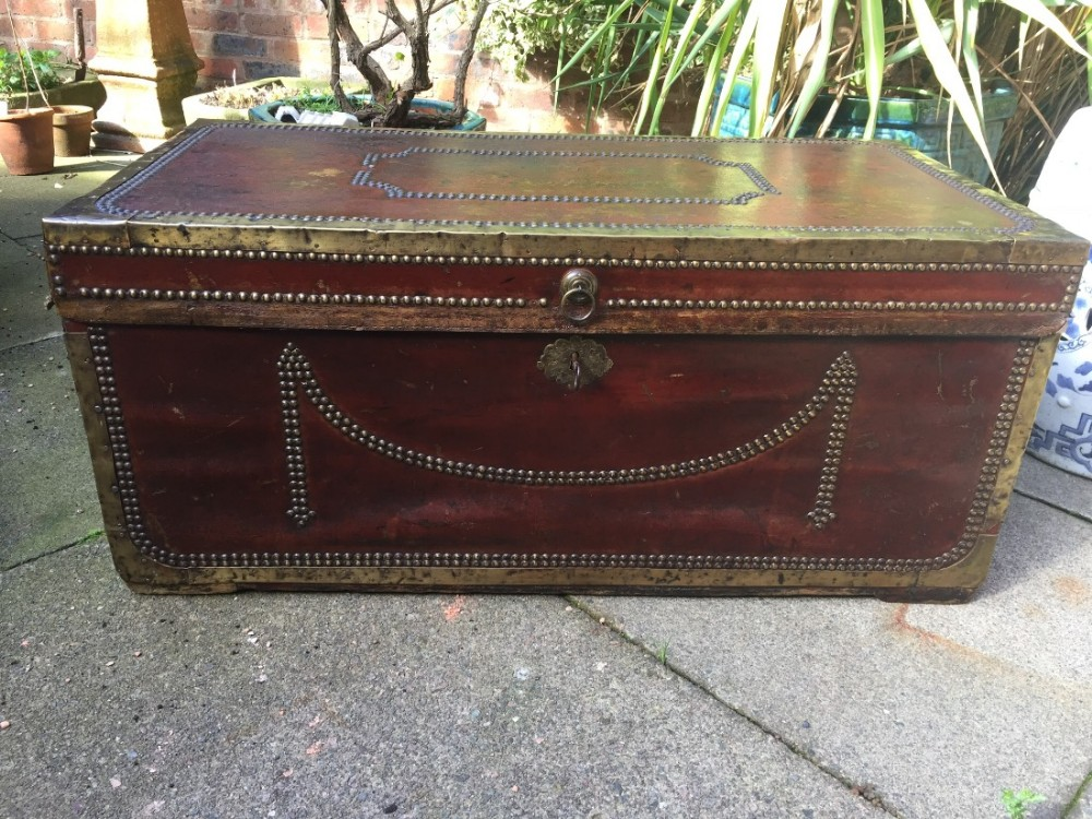 early c19th chinese export brassbound and studded burgundy leathercovered camphor trunk