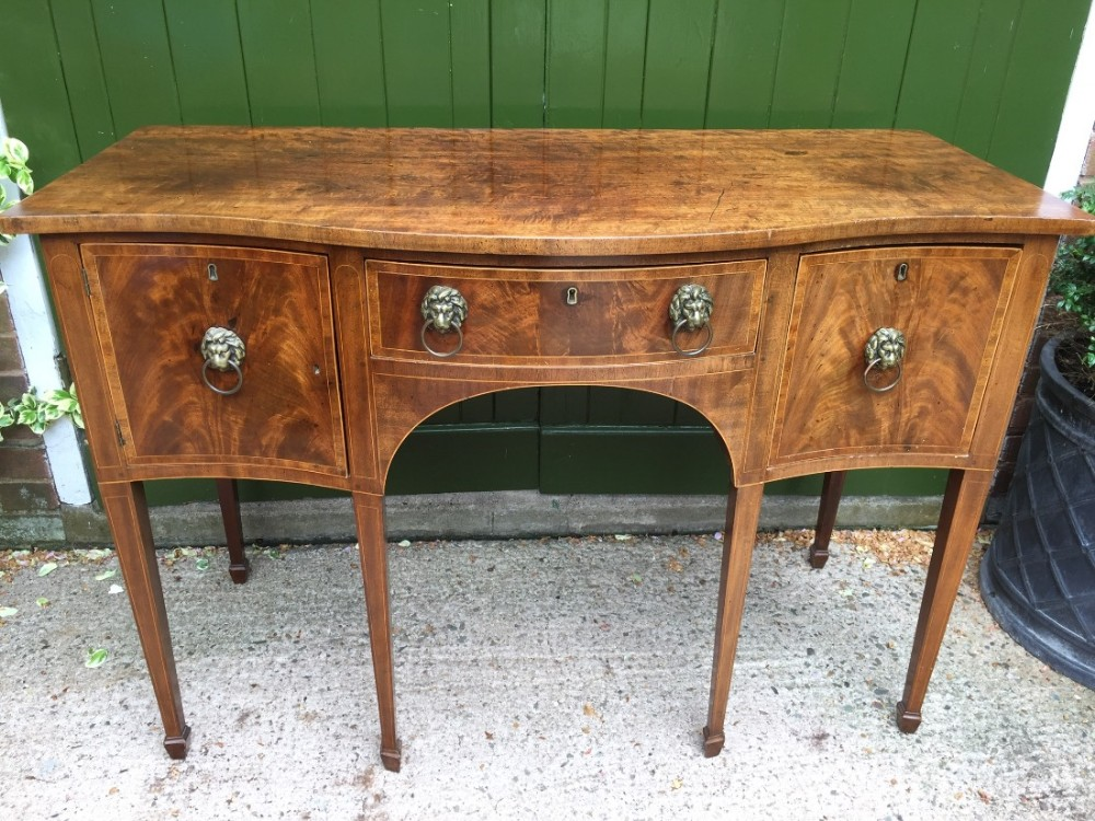 late c18th george iii period mahogany sideboard of serpentine outline and elegant compact proportions