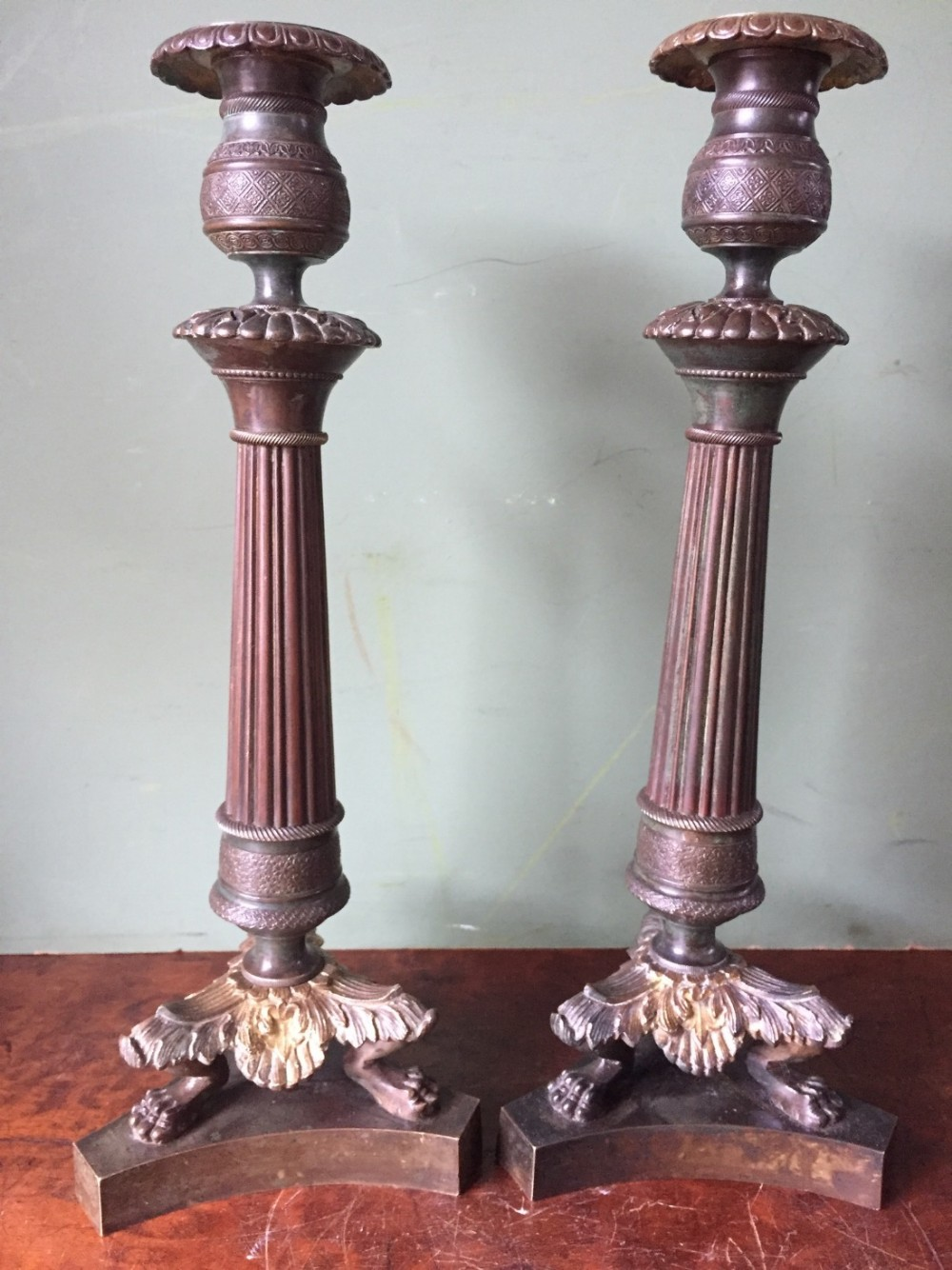pair of early c19th french charles x period bronze empire design candlesticks
