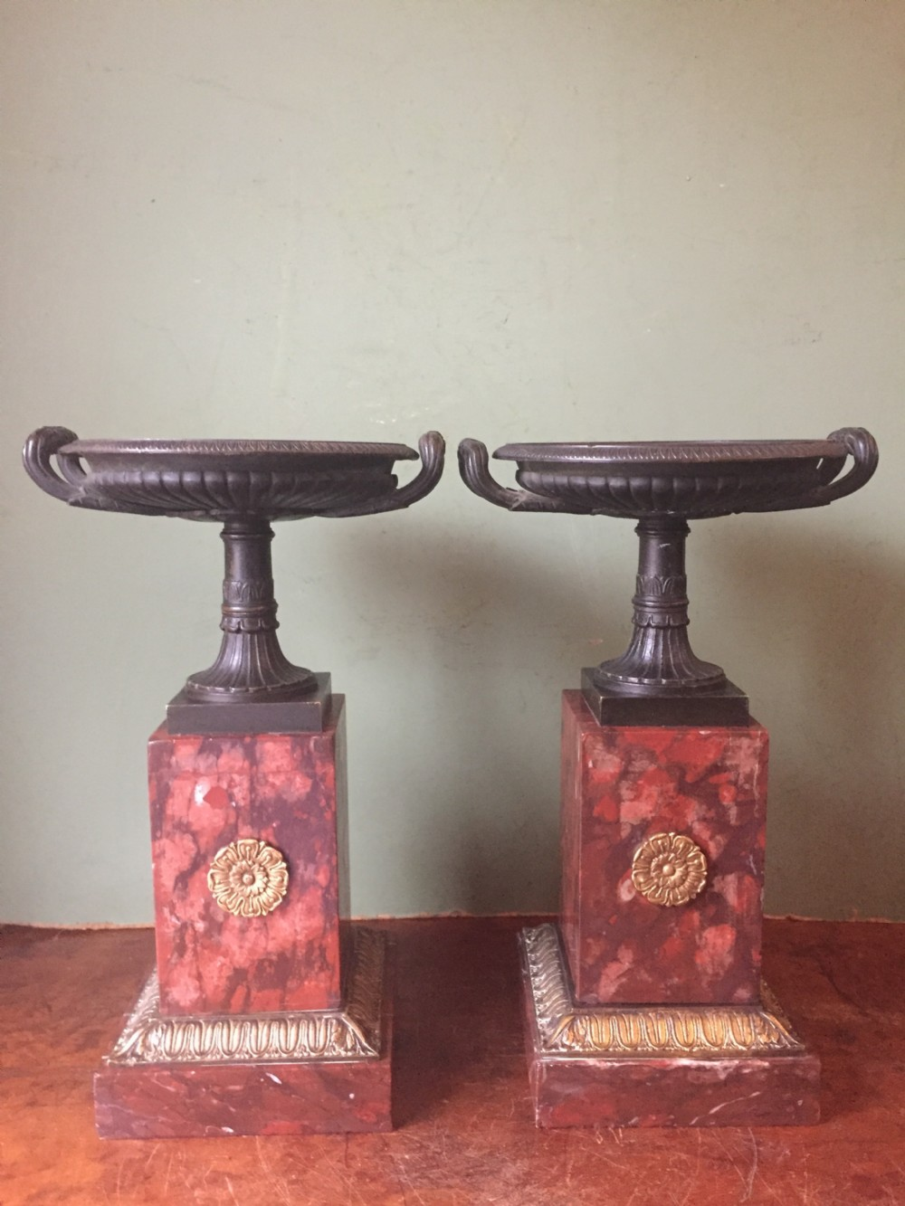 pair of early c19th french neoclassical empire design bronze tazzas on ormolumounted rouge marble vases