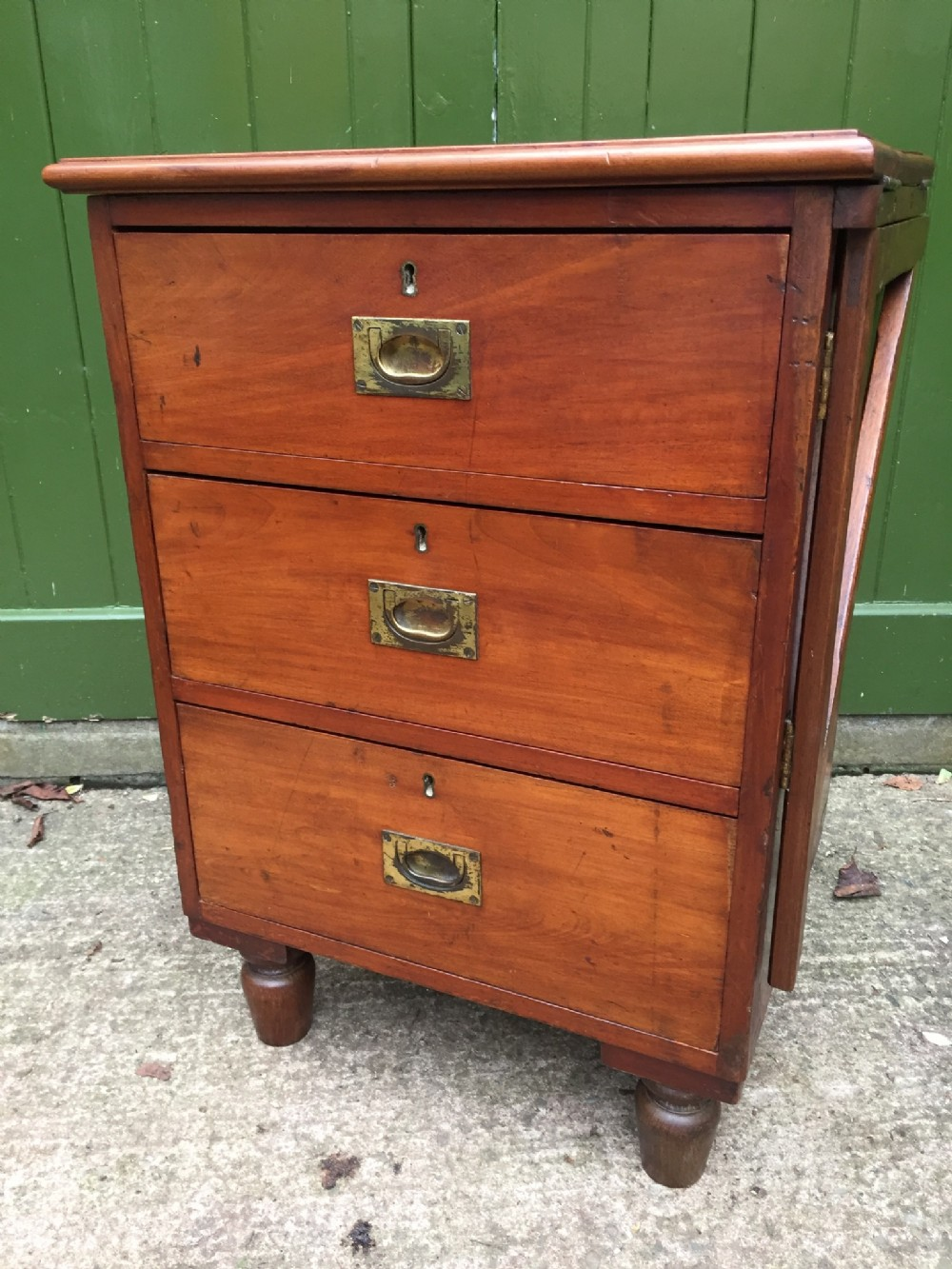 c19th mahogany military or naval campaign pedestal chest of drawers with a foldover flap top