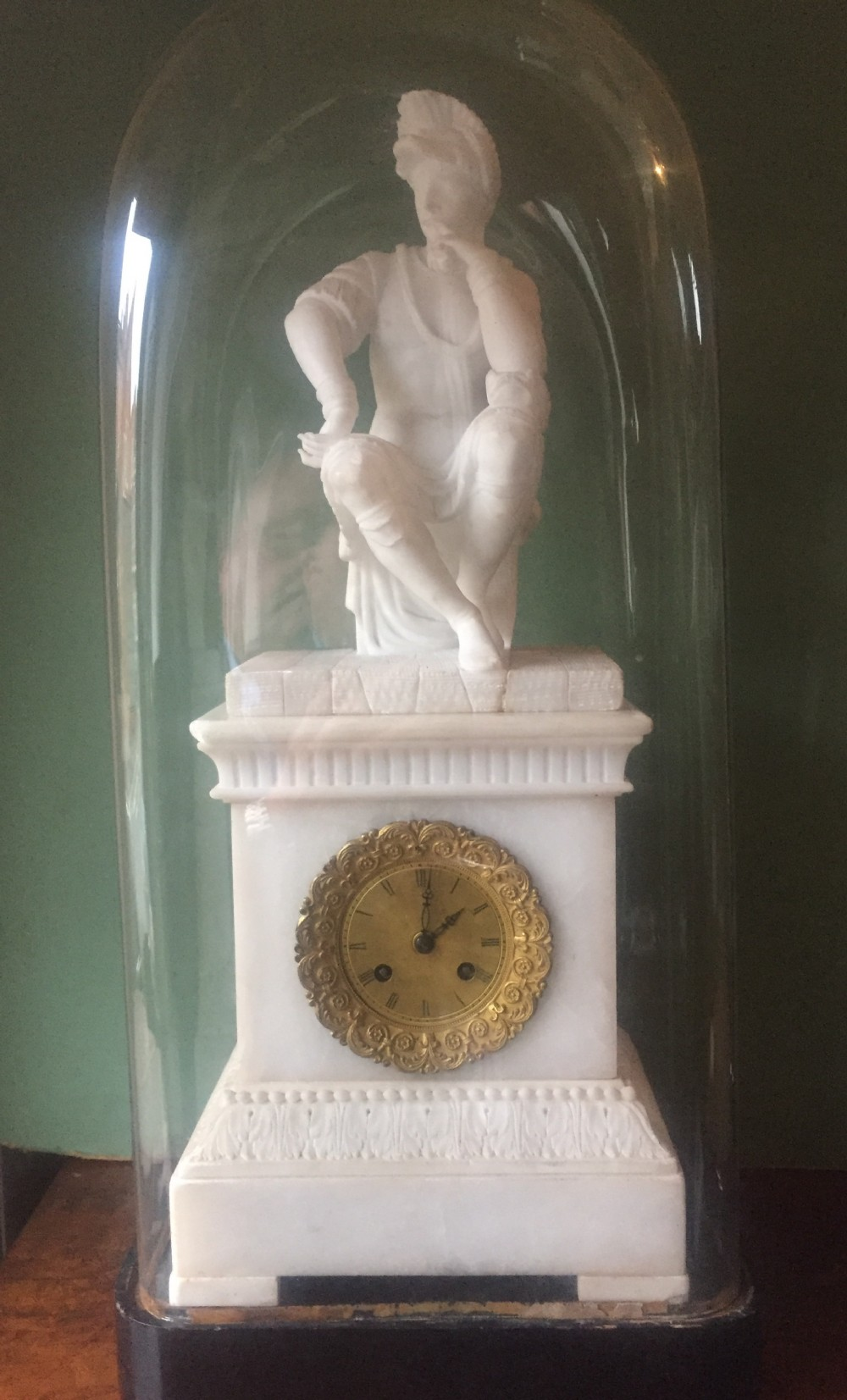 c19th italian carved alabaster mantel clock fitted with a french movement under glass dome