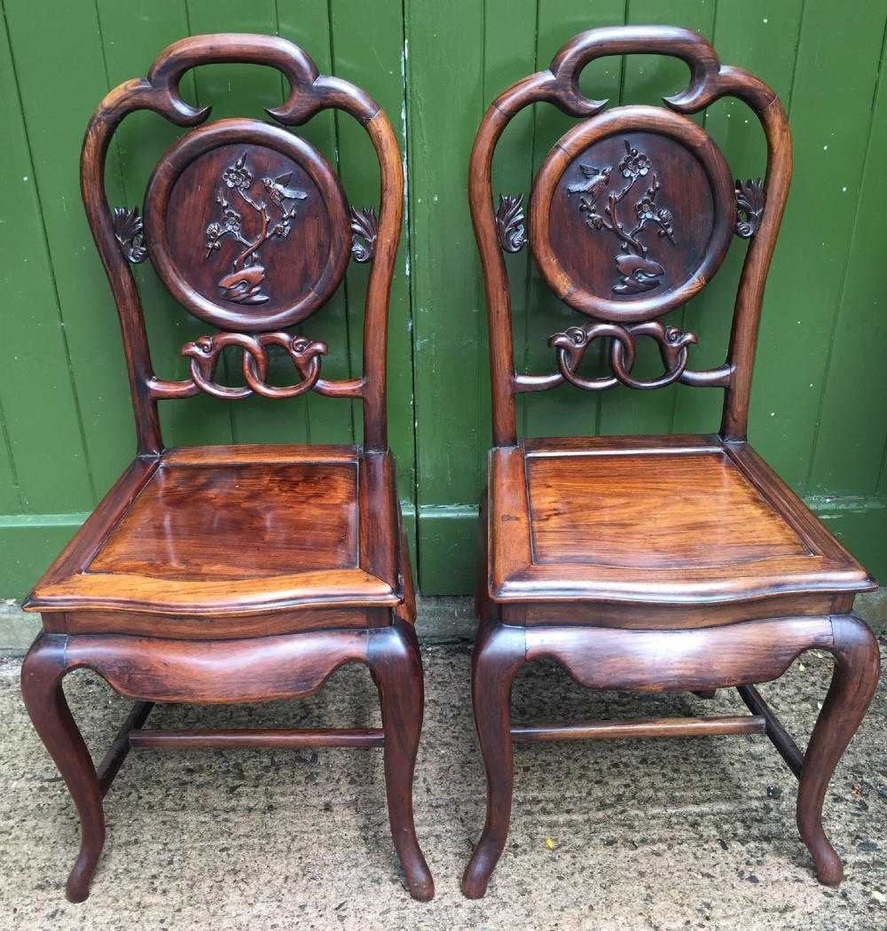 pair of late c19th chinese qing dynasty carved hardwood hall or side chairs