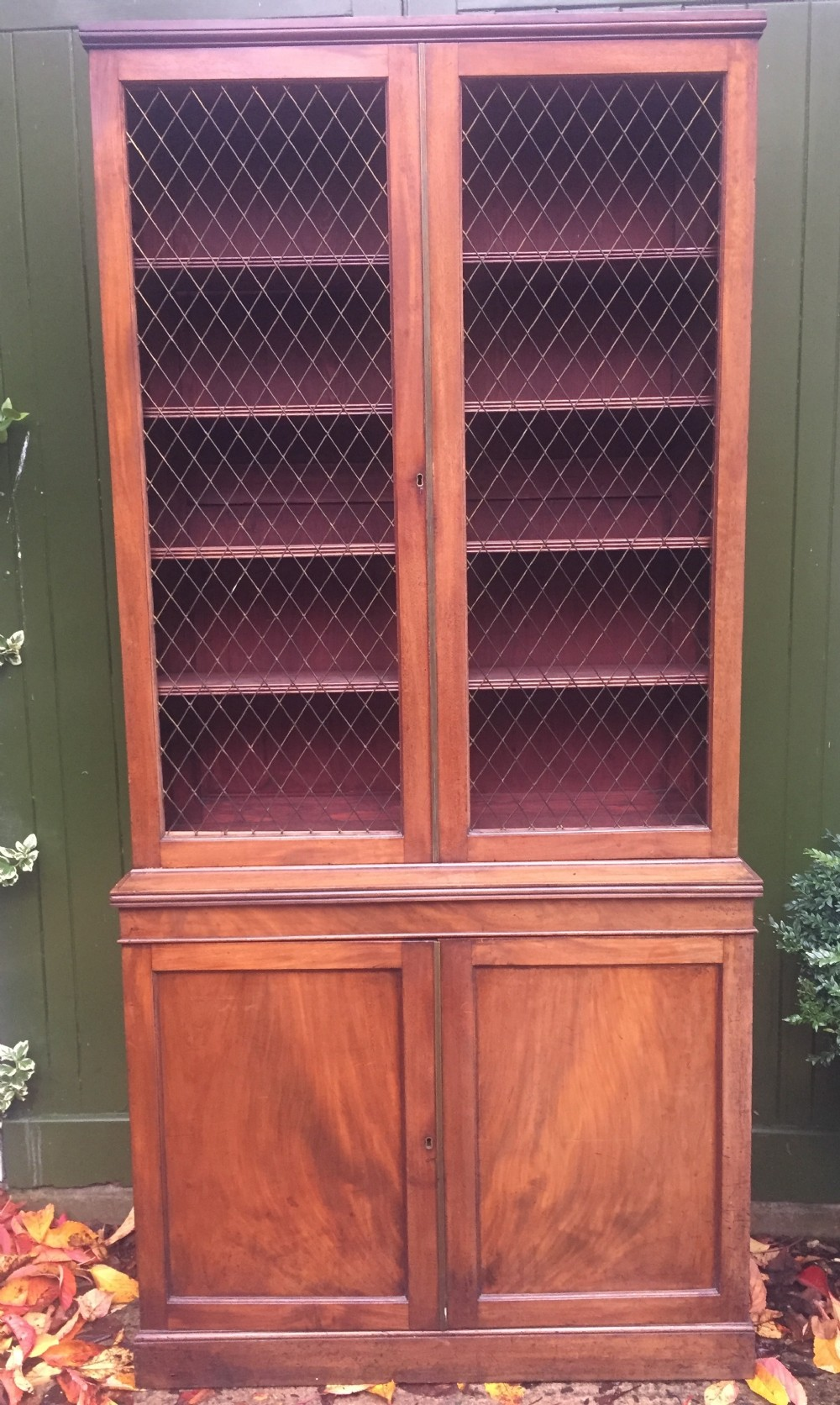 late c18th early c19th george iii period mahogany 2door bookcase with grille door top and cupboard base