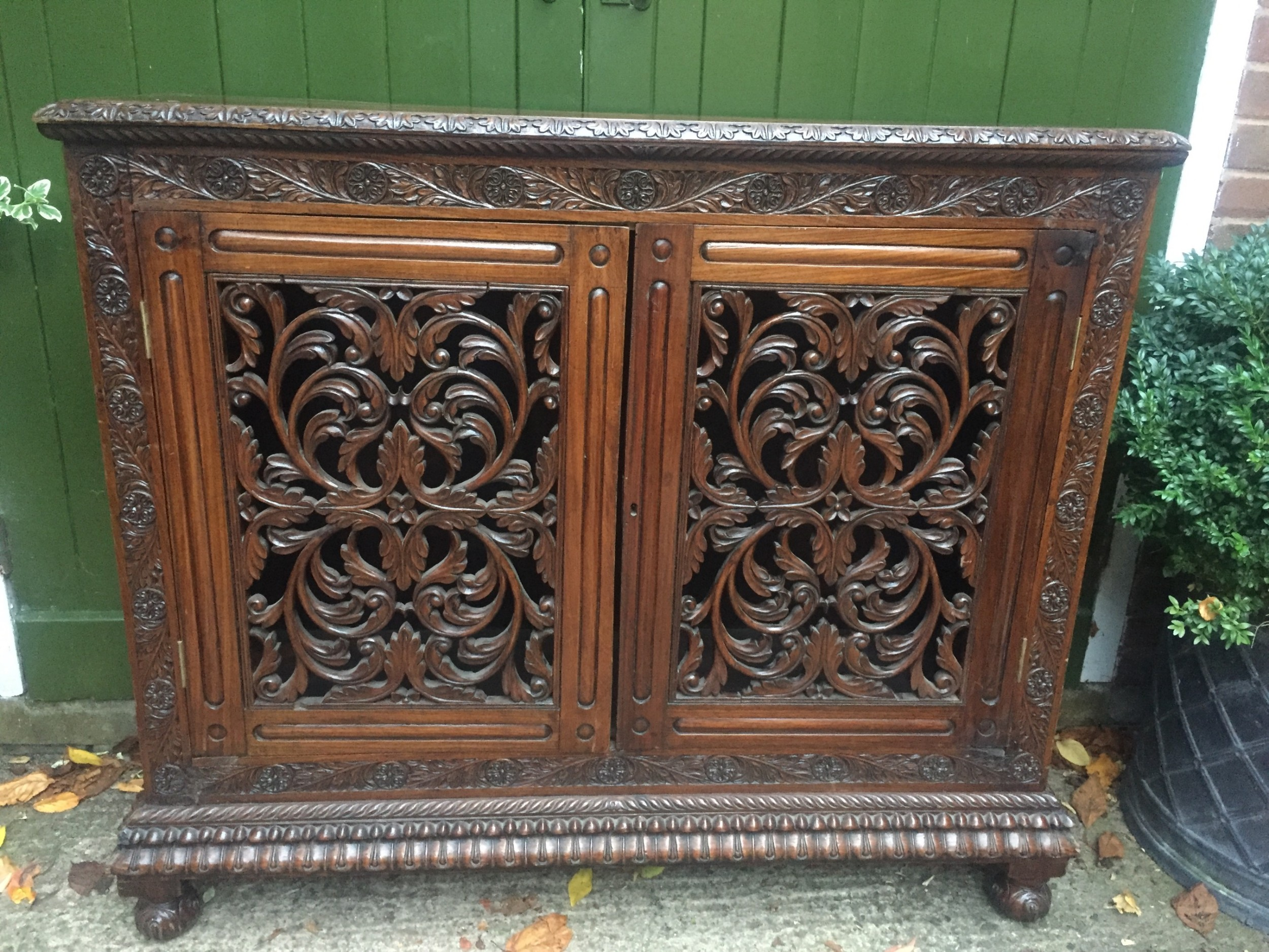 mid c19th angloindian carved padauk or rosewood dwarf bookcase or side cabinet
