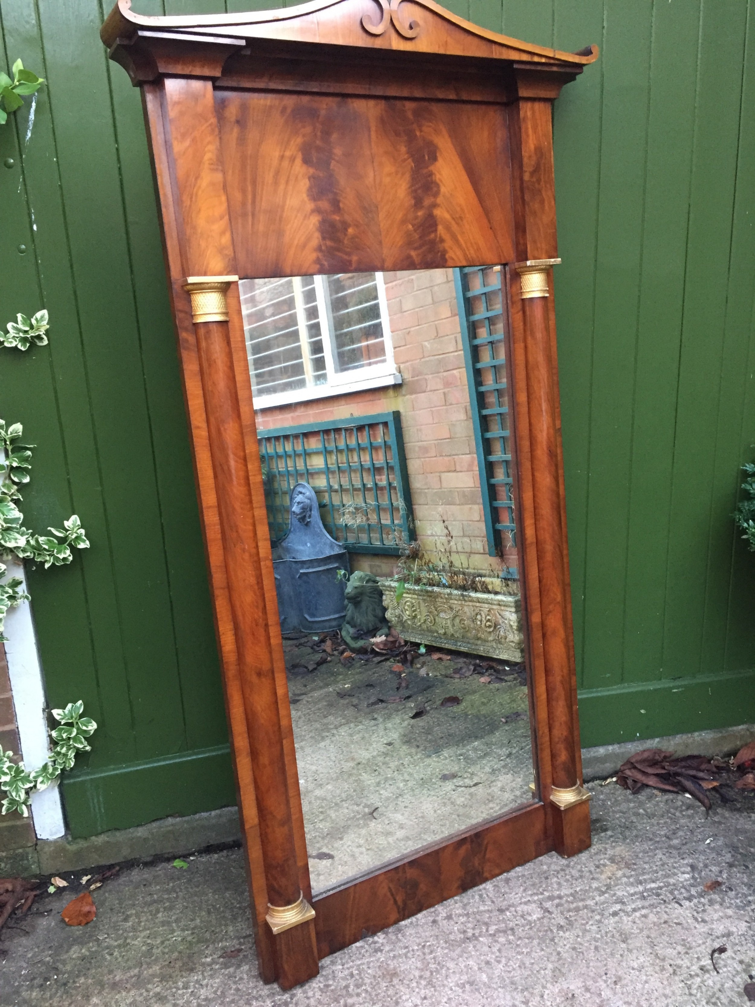 early c19th baltic region mahogany framed pier mirror with parcelgilt column caps and bases