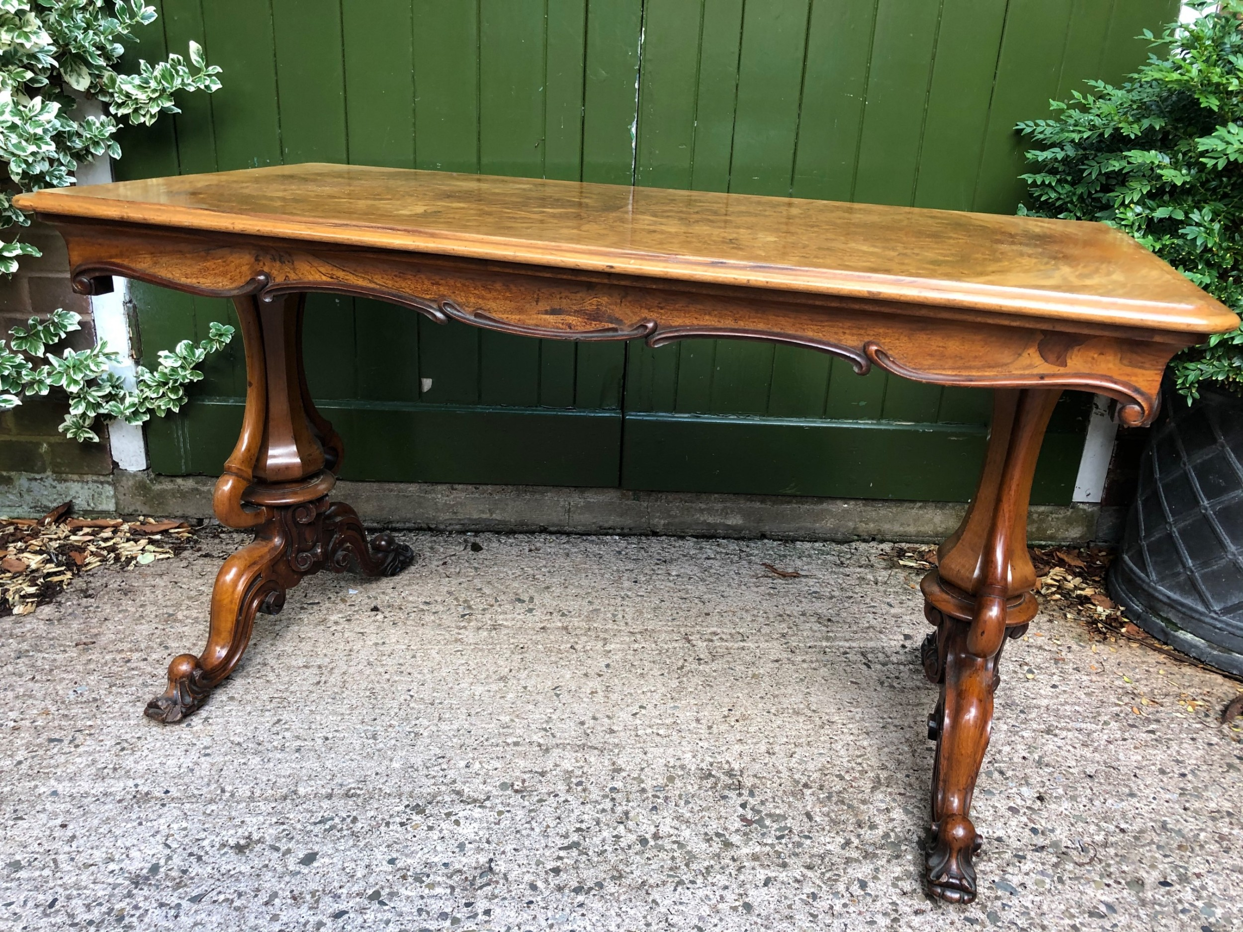 mid c19th early victorian period carved walnut centre or library table of freestanding form