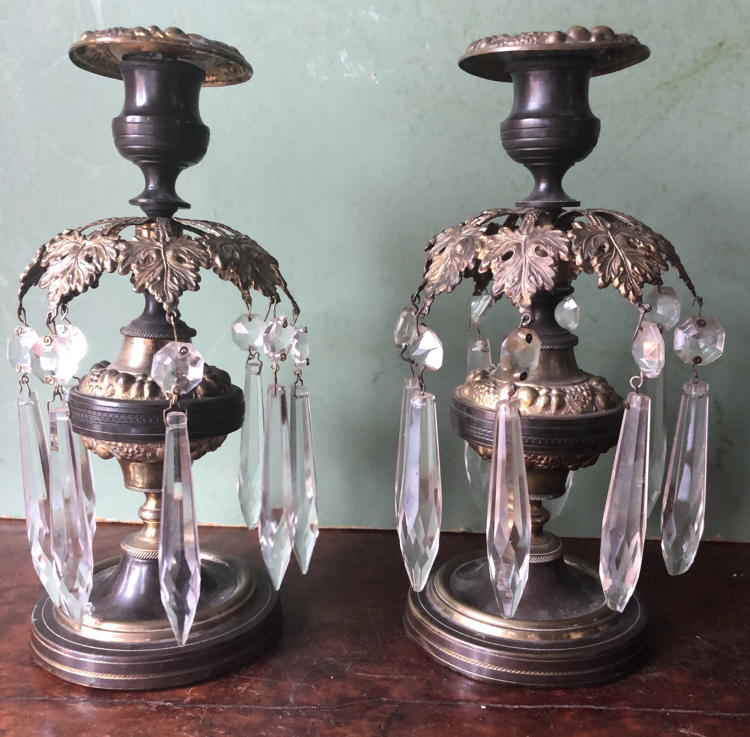 pair of early c19th regency period patinated and gilded bronze lustre candlesticks