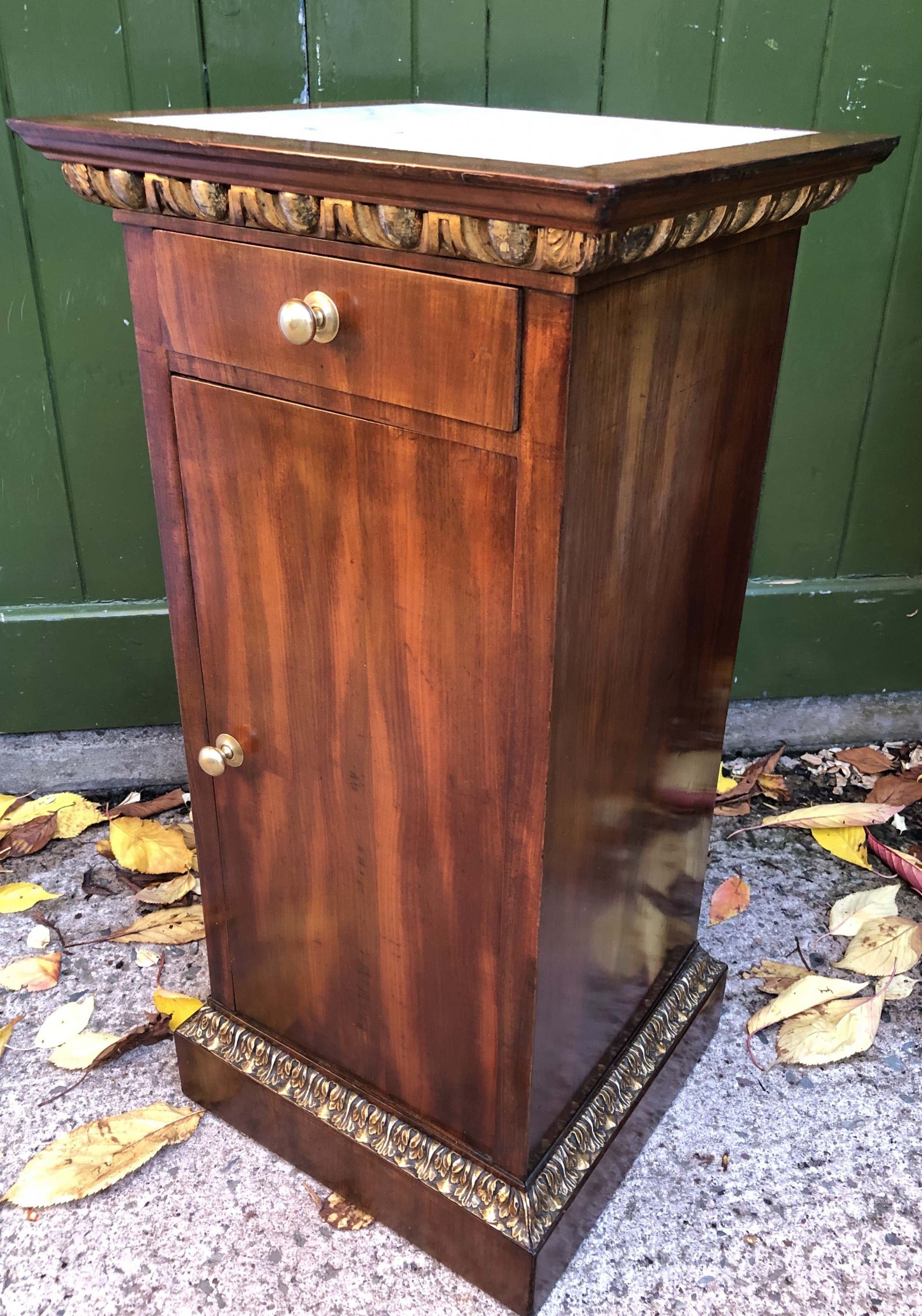 early c19th italian mahogany and carved parcelgilt marbletopped pedestal bedside cupboard