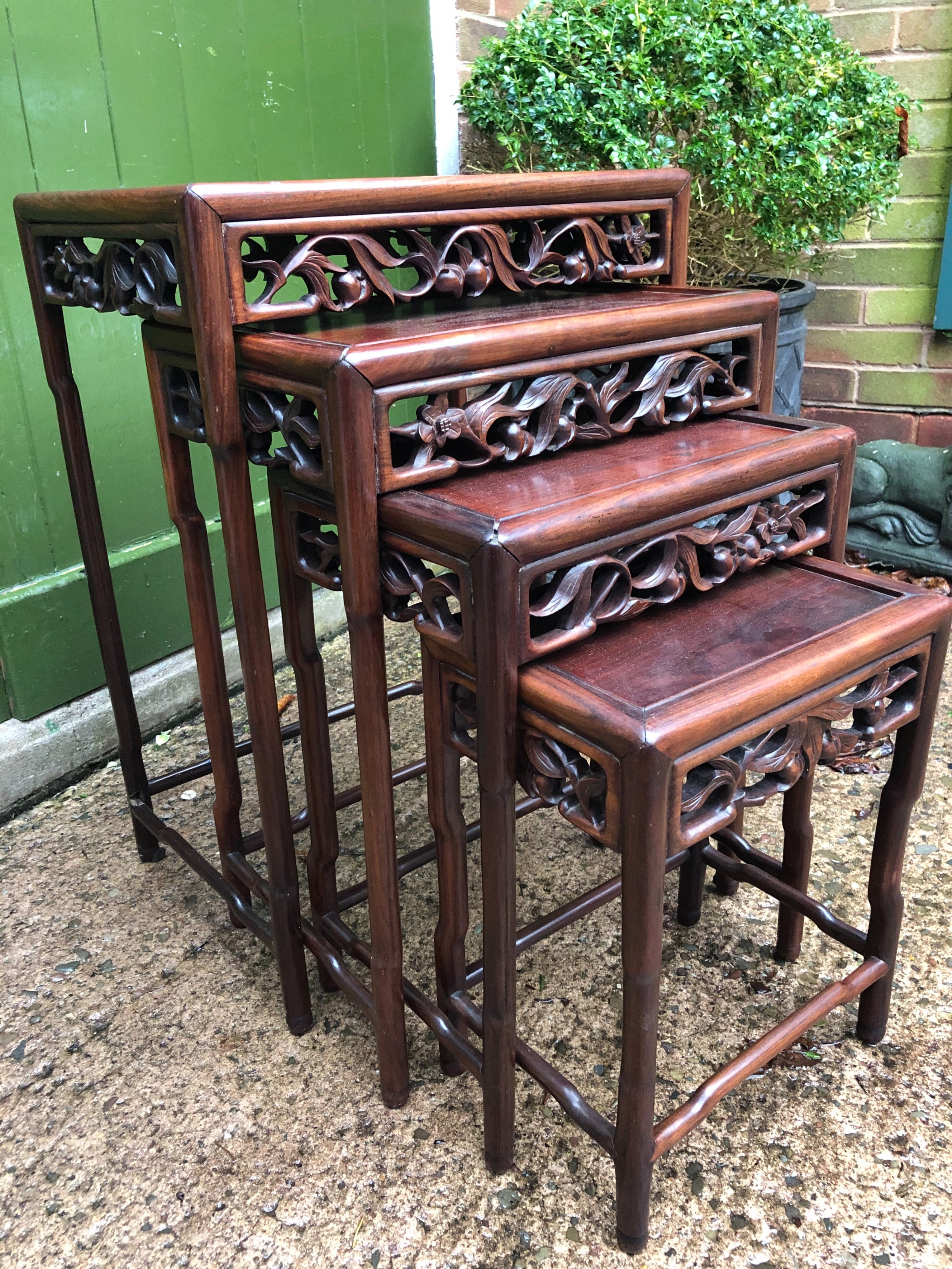 set of 4 late c19th early c20th chinese qing dynasty carved hardwood nesting tables