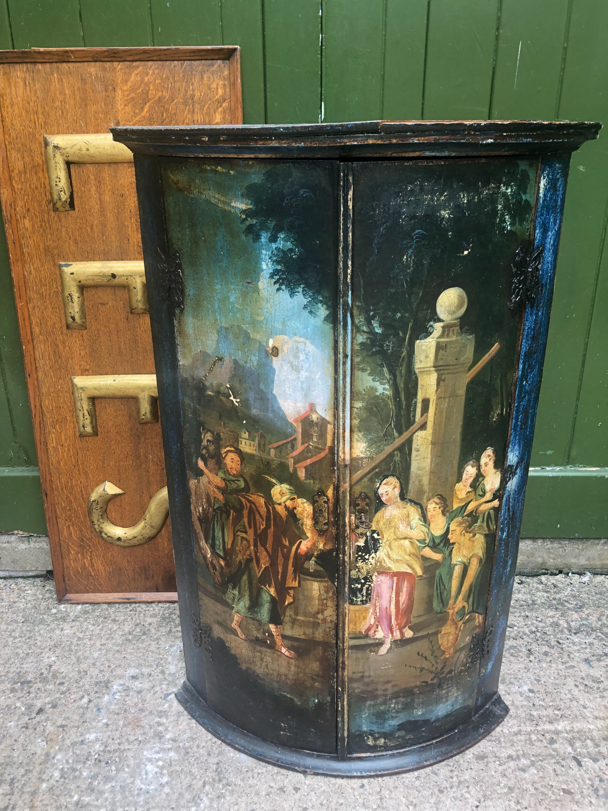 c18th dutch bowfront hanging corner cupboard decorated with an exotic figural scene