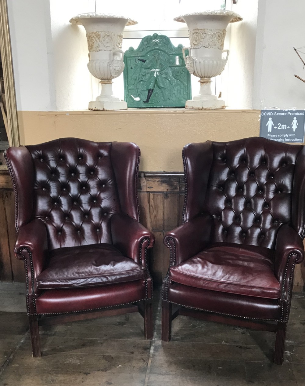 pair of georgian style leather chesterfield wingbacks
