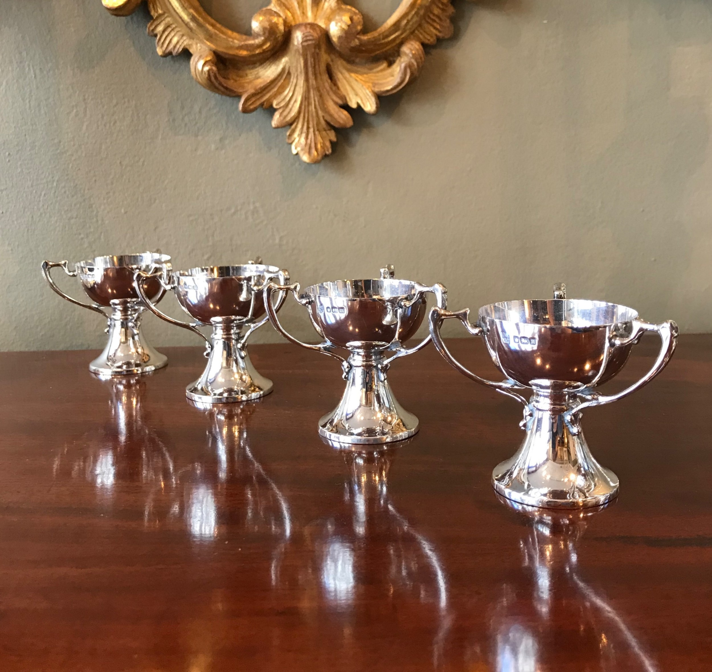 set of four art nouveau silver salts cups in the form of tygs