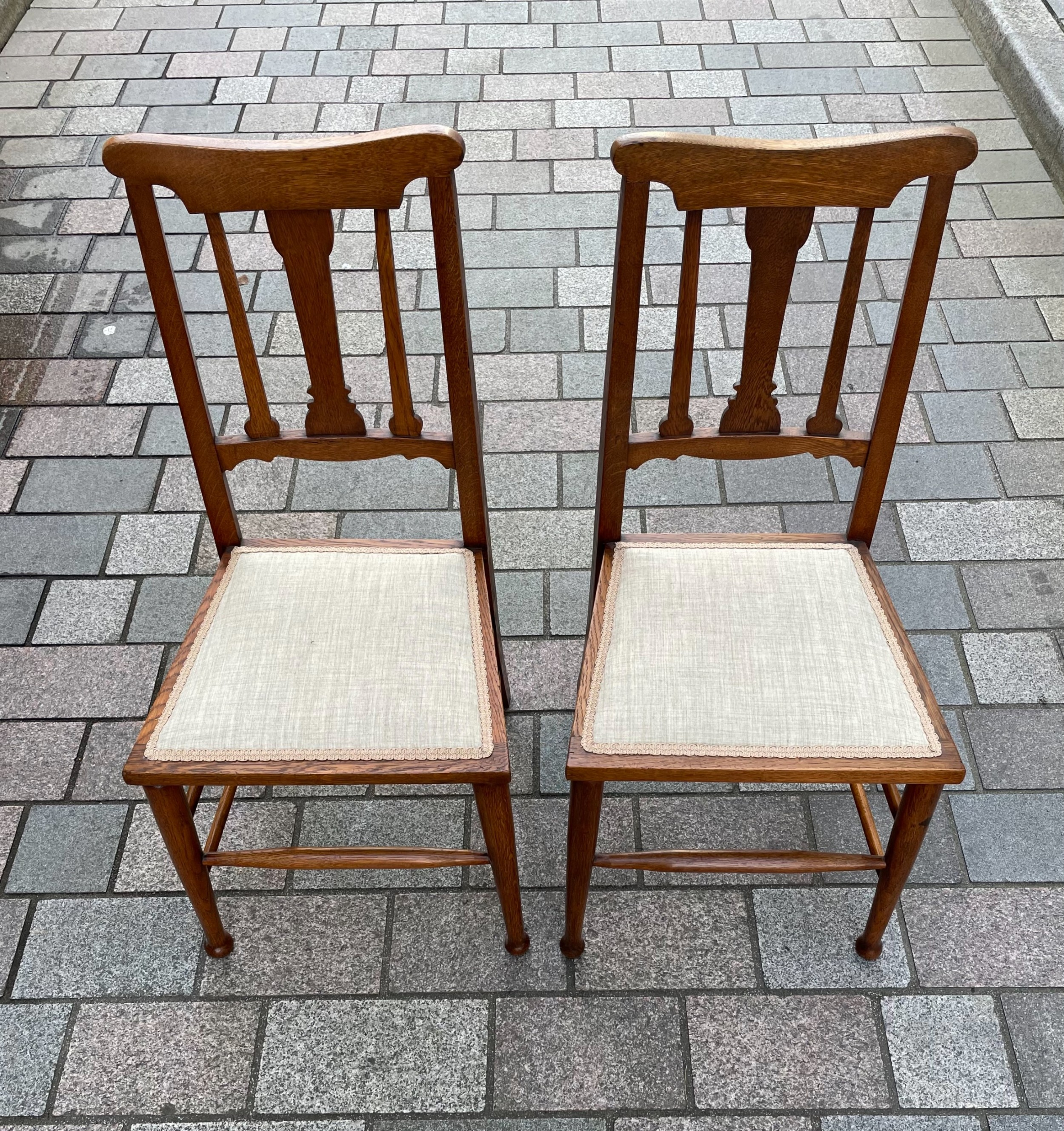 pair of arts crafts oak chairs