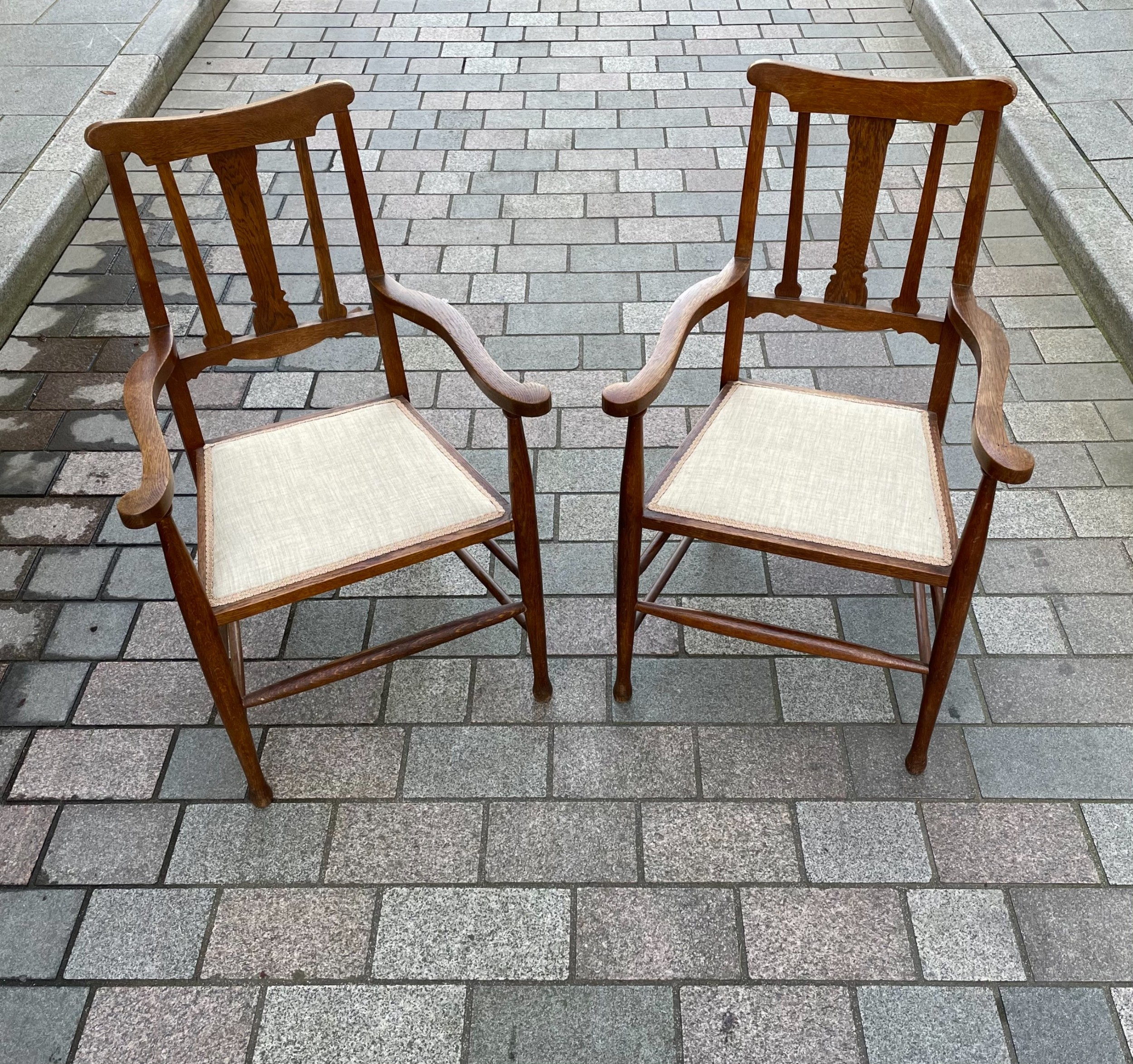 pair of arts crafts oak carver chairs