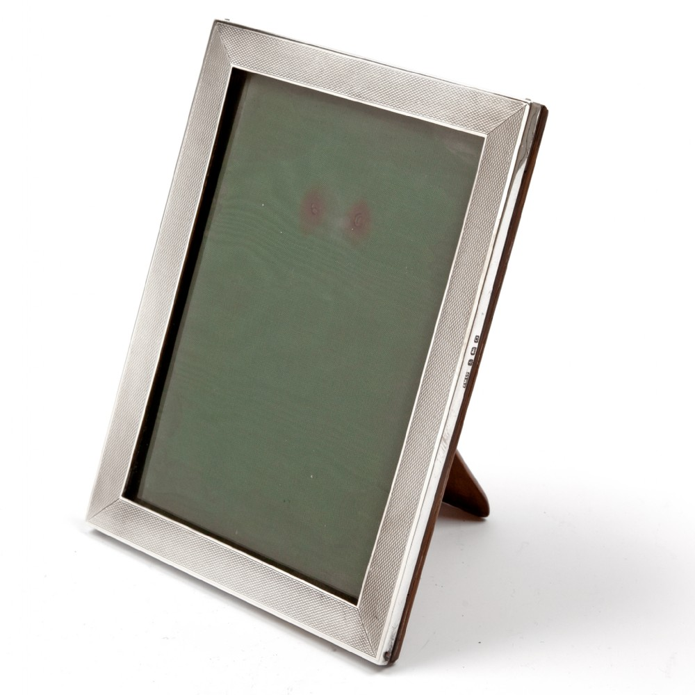 vintage silver photo picture frame with an engine turned style border