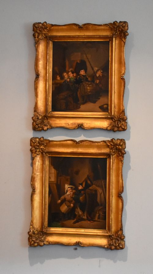 pair of oil paintings of children playing soldiers