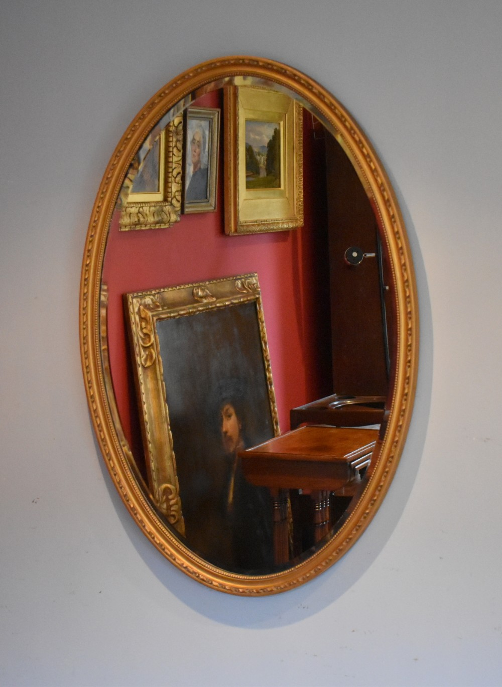 large edwardian oval gilt mirror