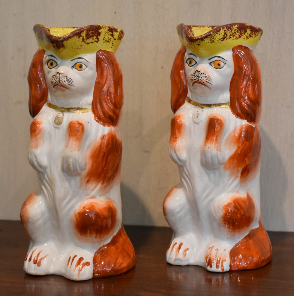 a pair of staffordshire dog toby jugs