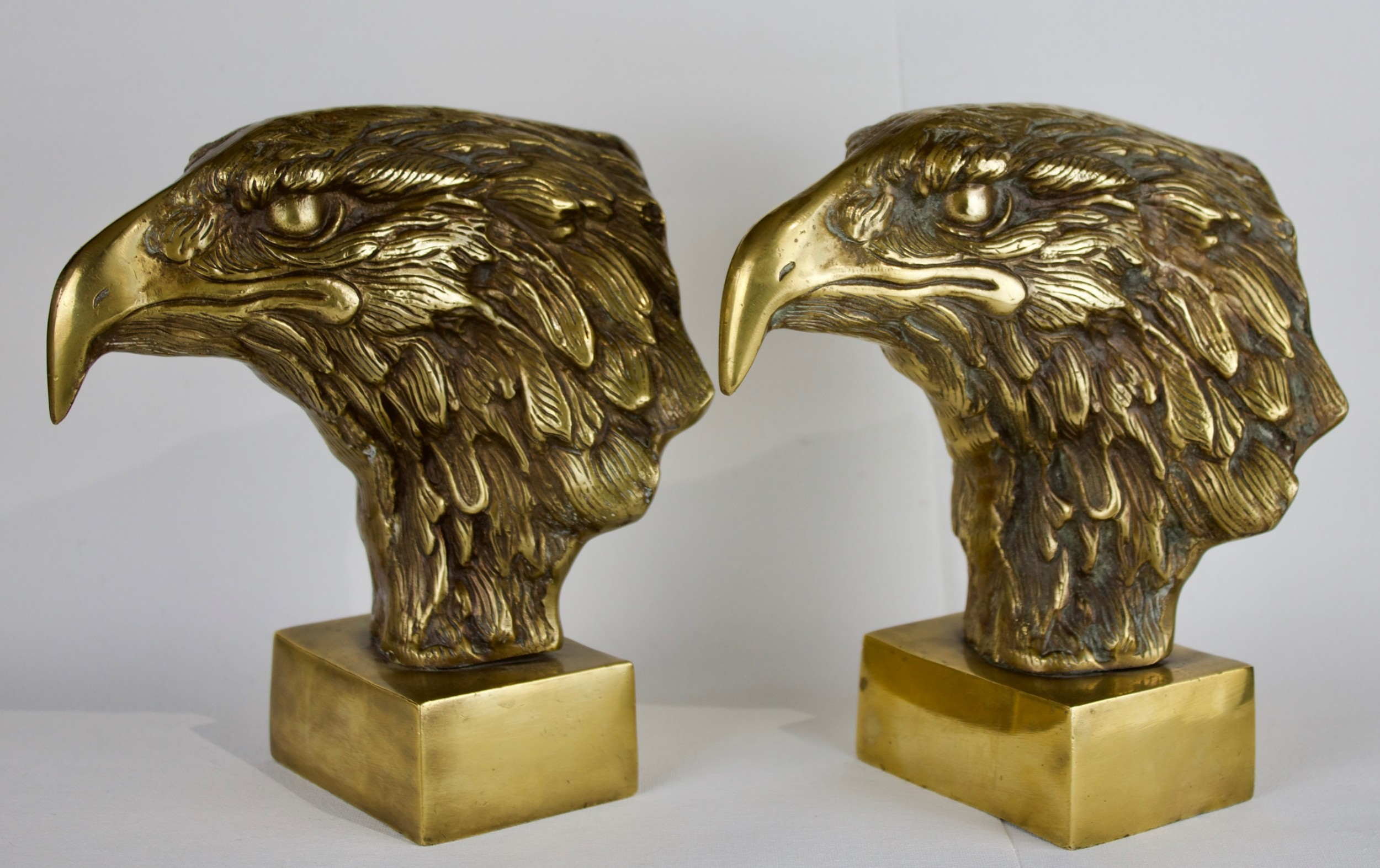 a pair of sculpturedeagle heads