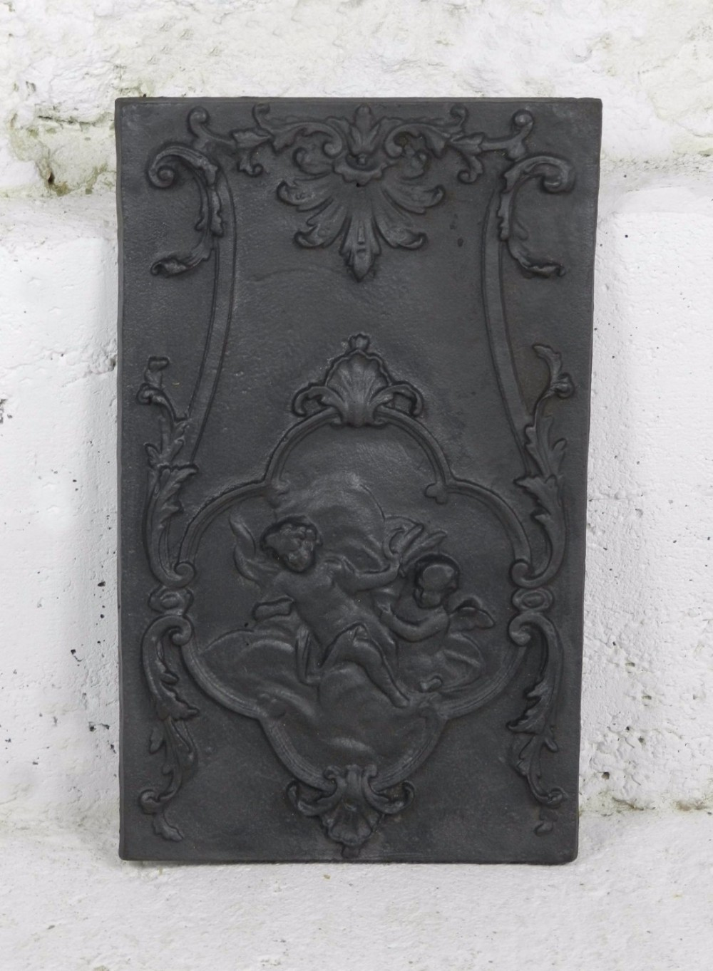 french fire back plate decorated with cherubs