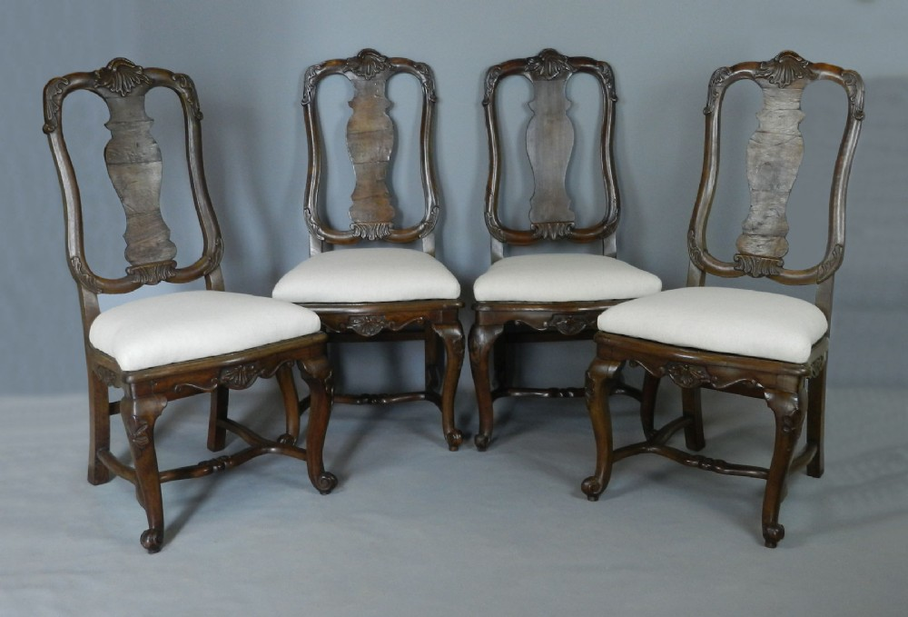 continental set of four queen anne style walnut chairs