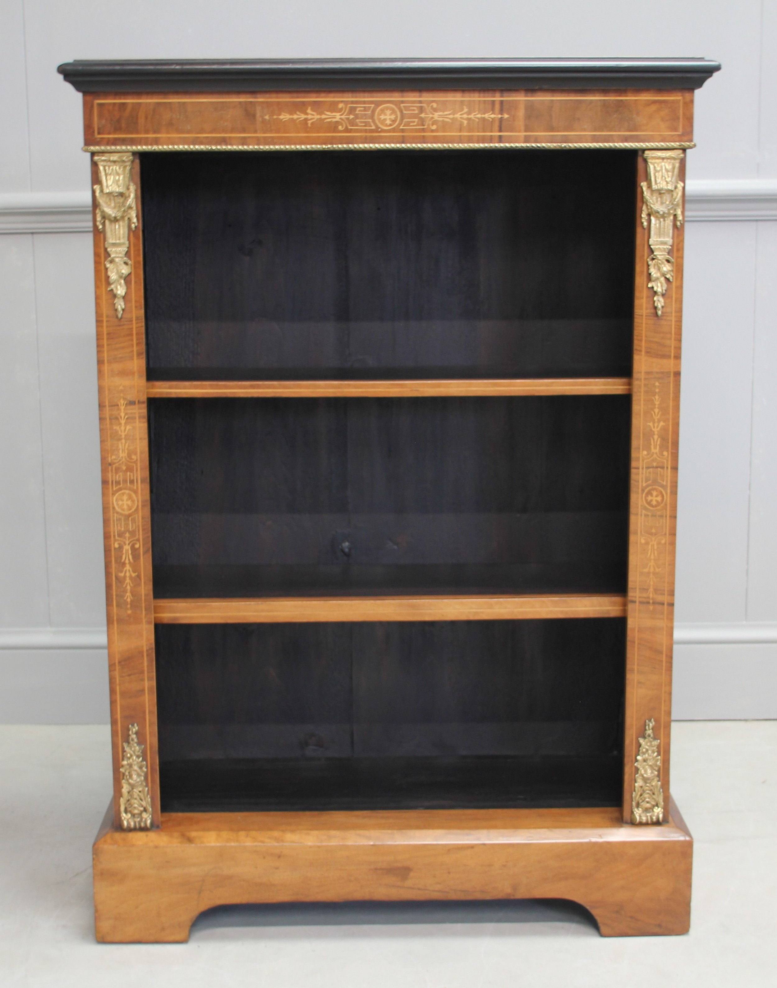 a 19th century walnut open bookcase