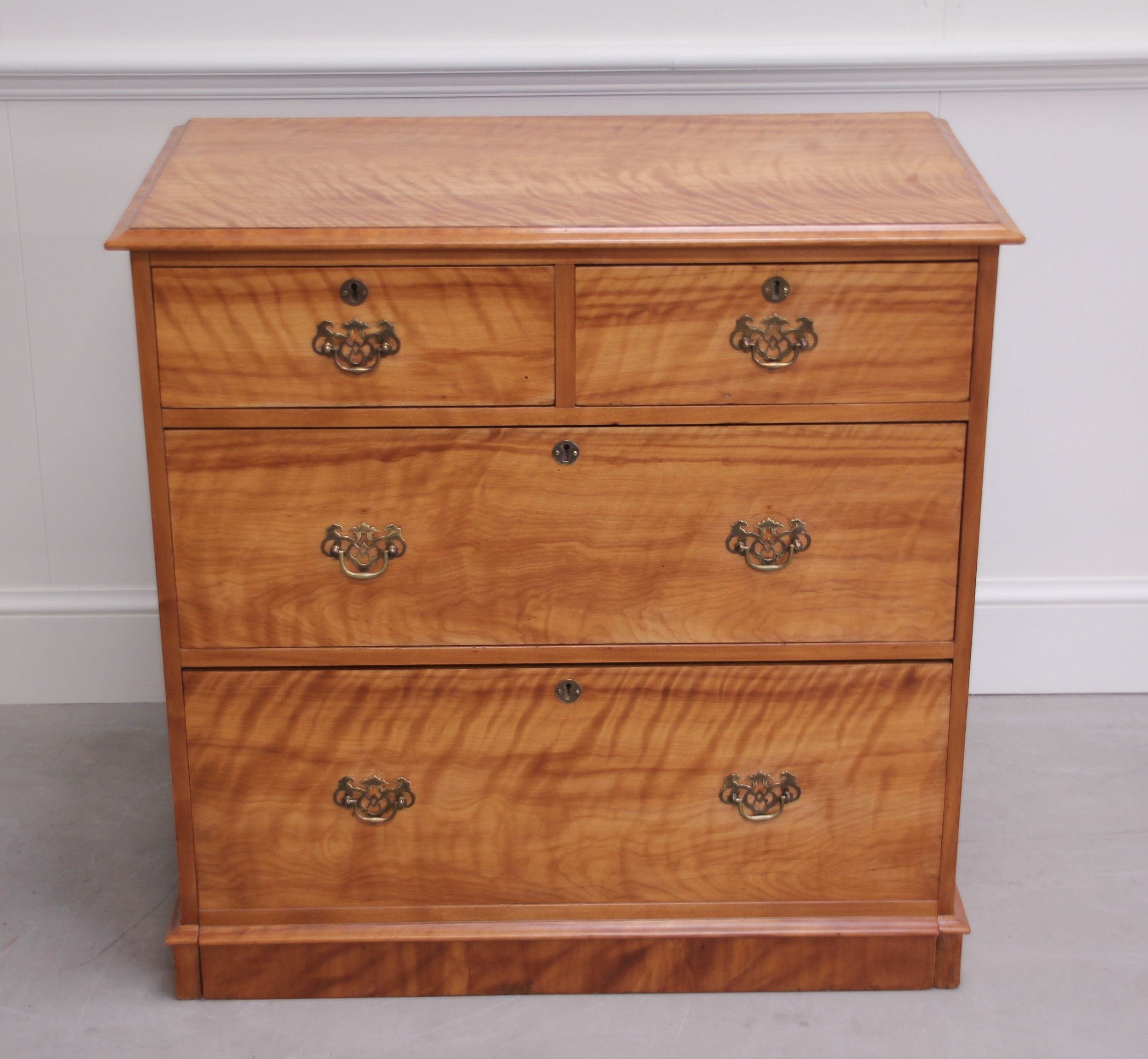 a 19th century satin birch chest of drawers
