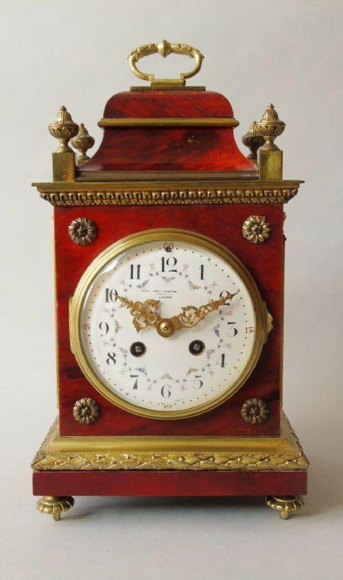 red tortoiseshell gilt metal striking bracket clock