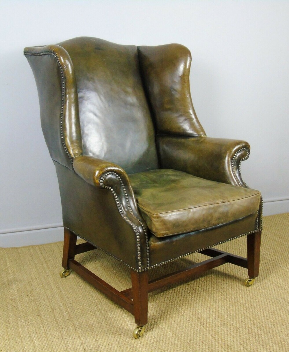 good regency style antique leather wing back armchair