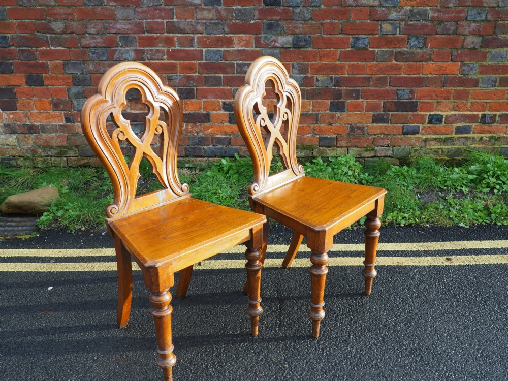 pair of gothic influenced oak hall chairs