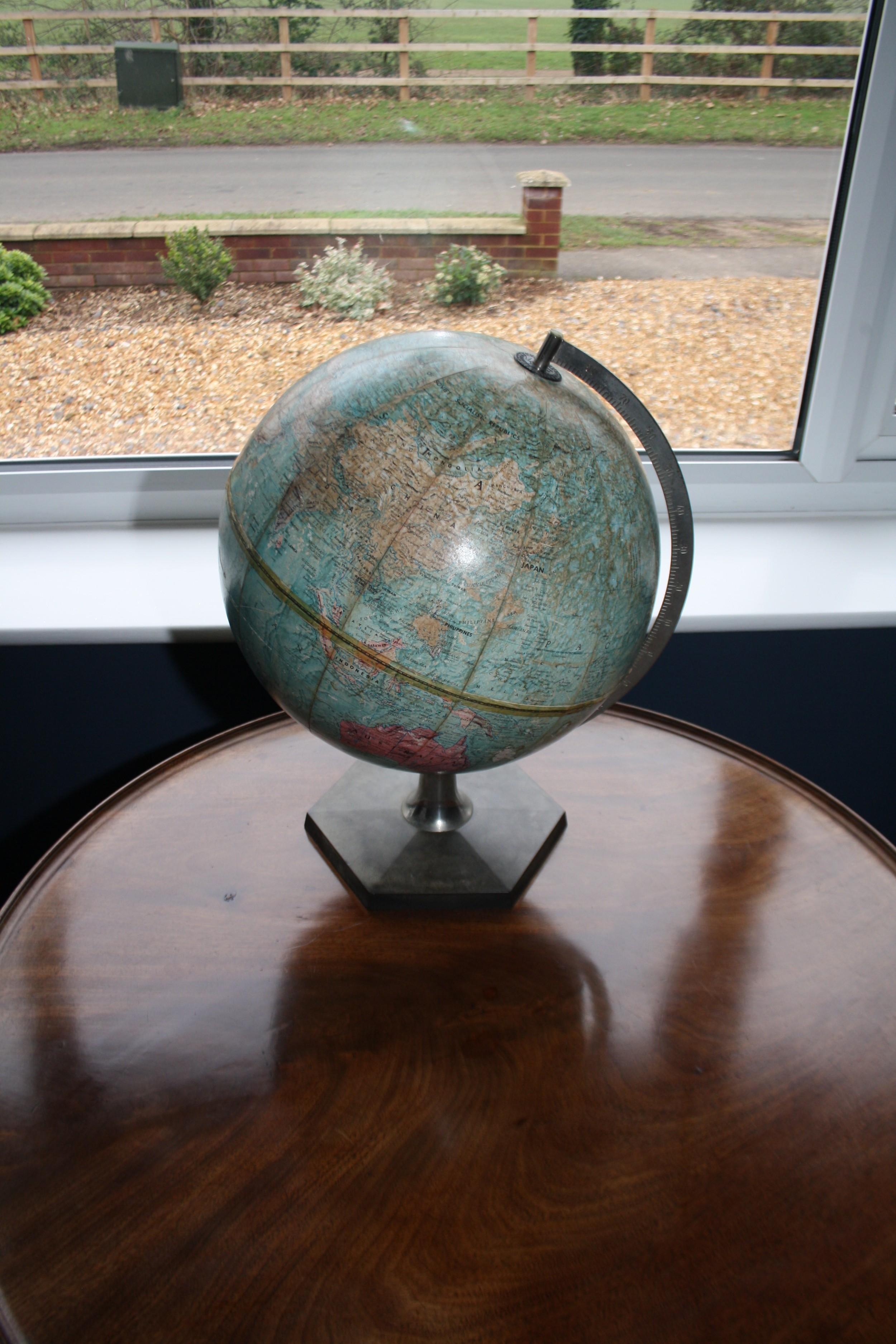early 20th century globe with bakelite base