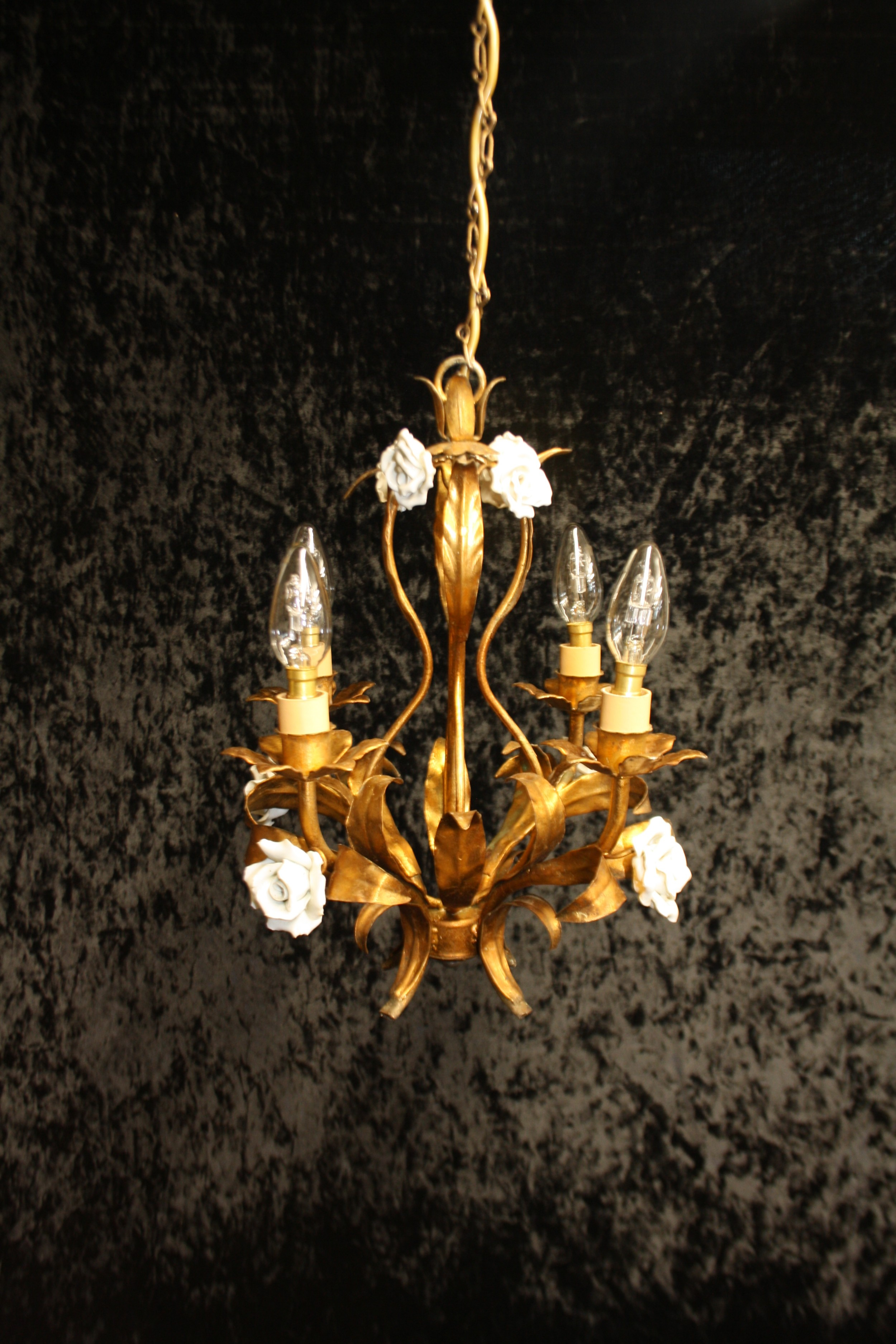 four arm french gilt chandelier with porcelain flowers
