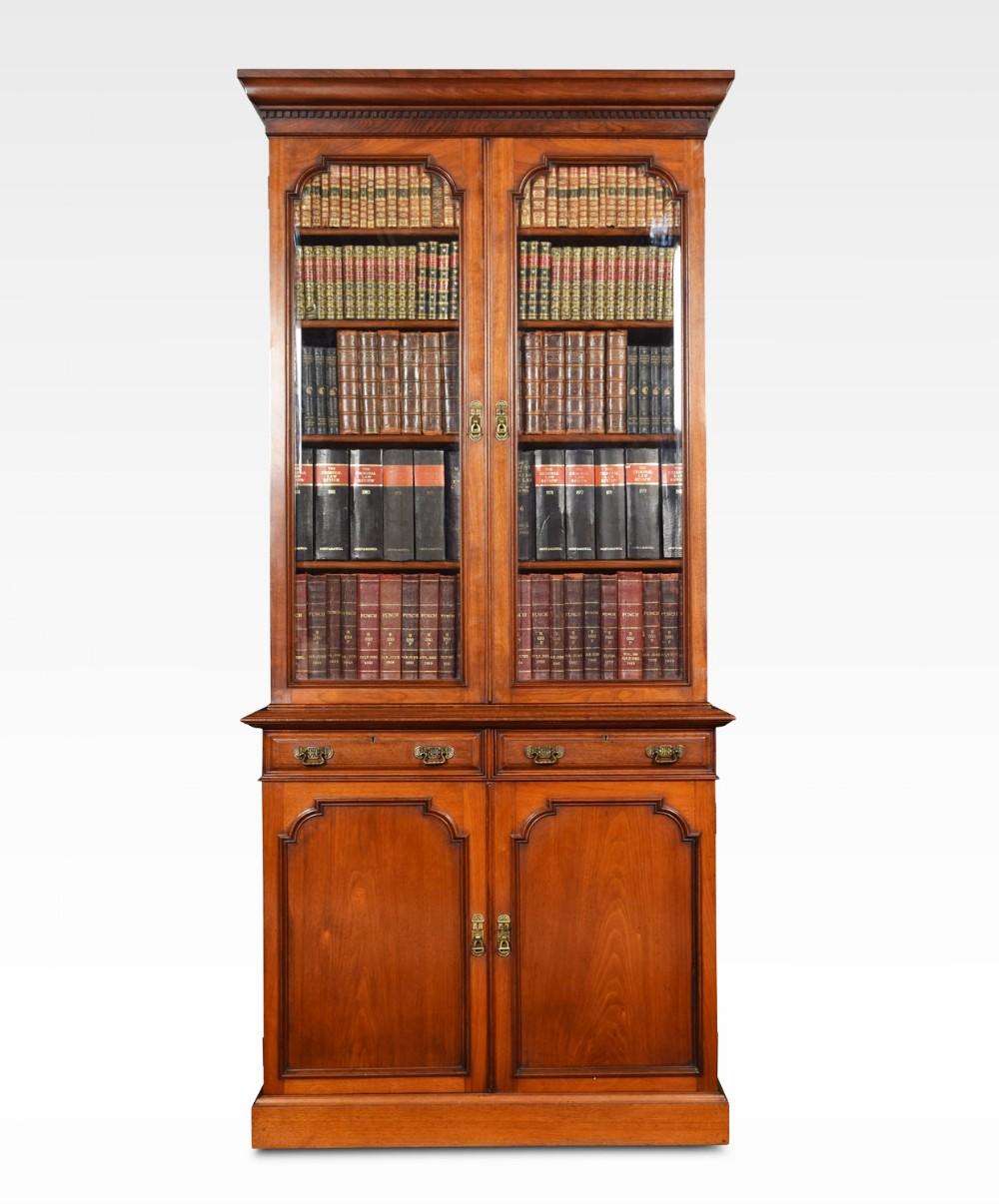 two door narrow walnut bookcase