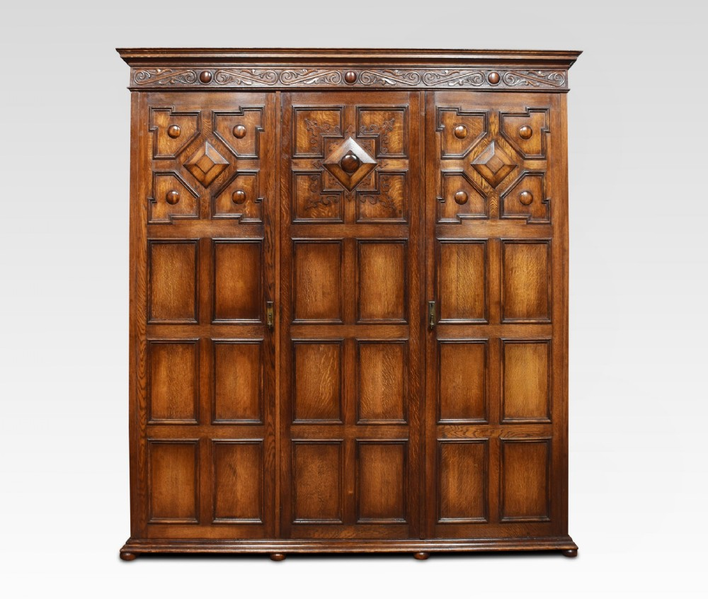 jacobean style carved oak three door wardrobe