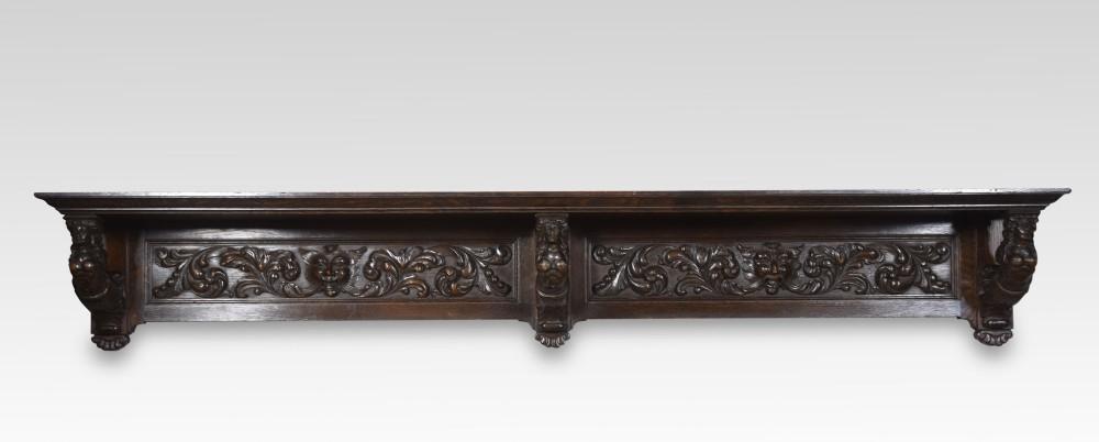large carved oak shelf