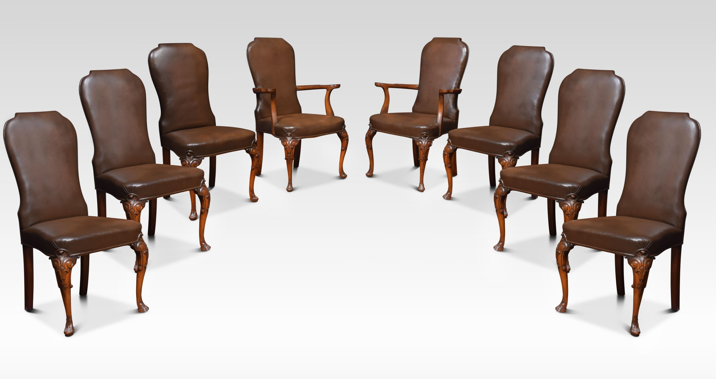 set of eight high back brown leather upholstered dining chairs