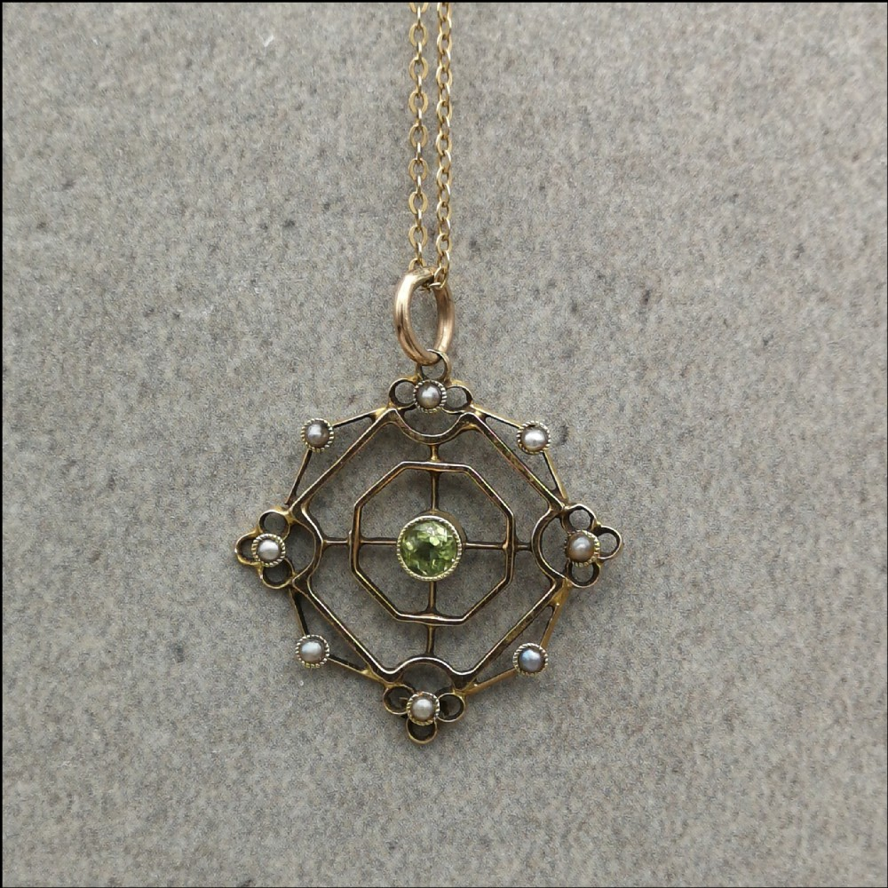 15ct gold peridot and seed pearls art nouveau lavalier pendant with 9ct gold chain