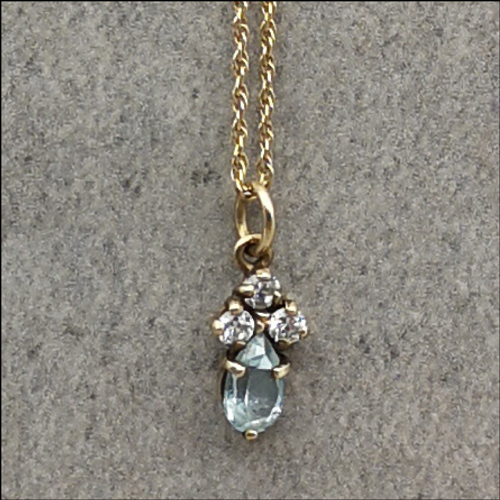 9ct gold blue topaz and white sapphire pendant and chain