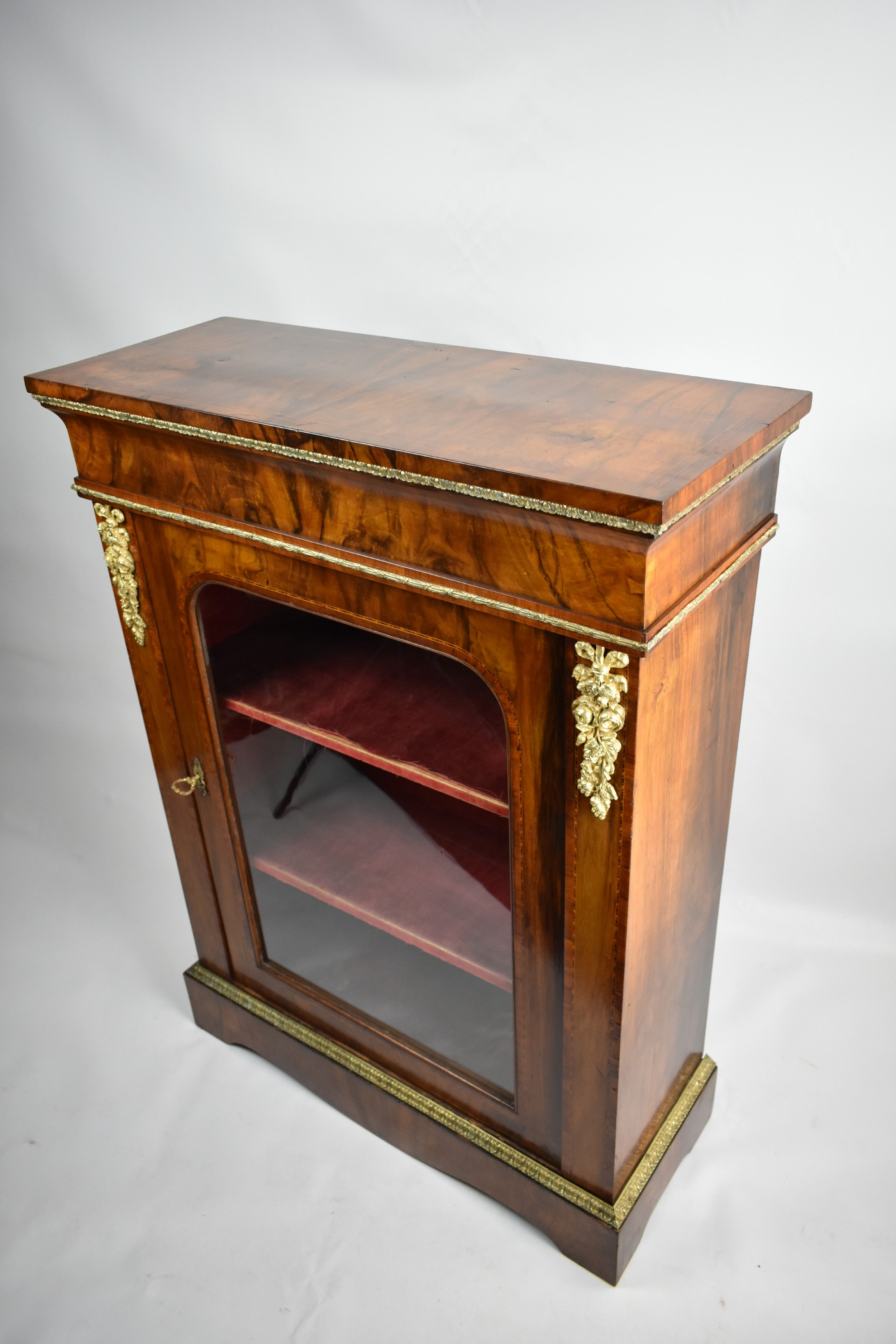 a mid victorian figured walnut and tulipwood banded pier cabinet with ormolu mounts
