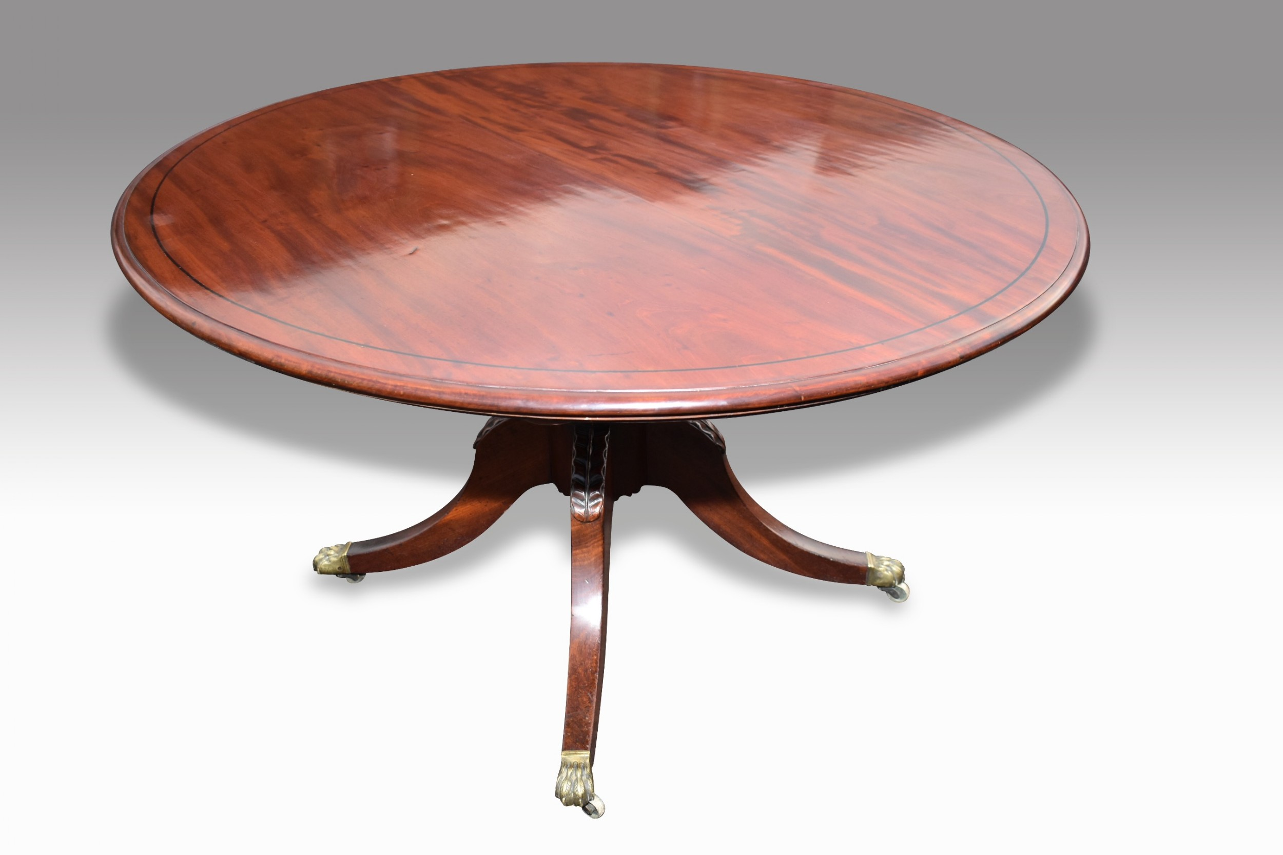 a fine quality regency mahogany ebony inlaid tilt top oval breakfast table