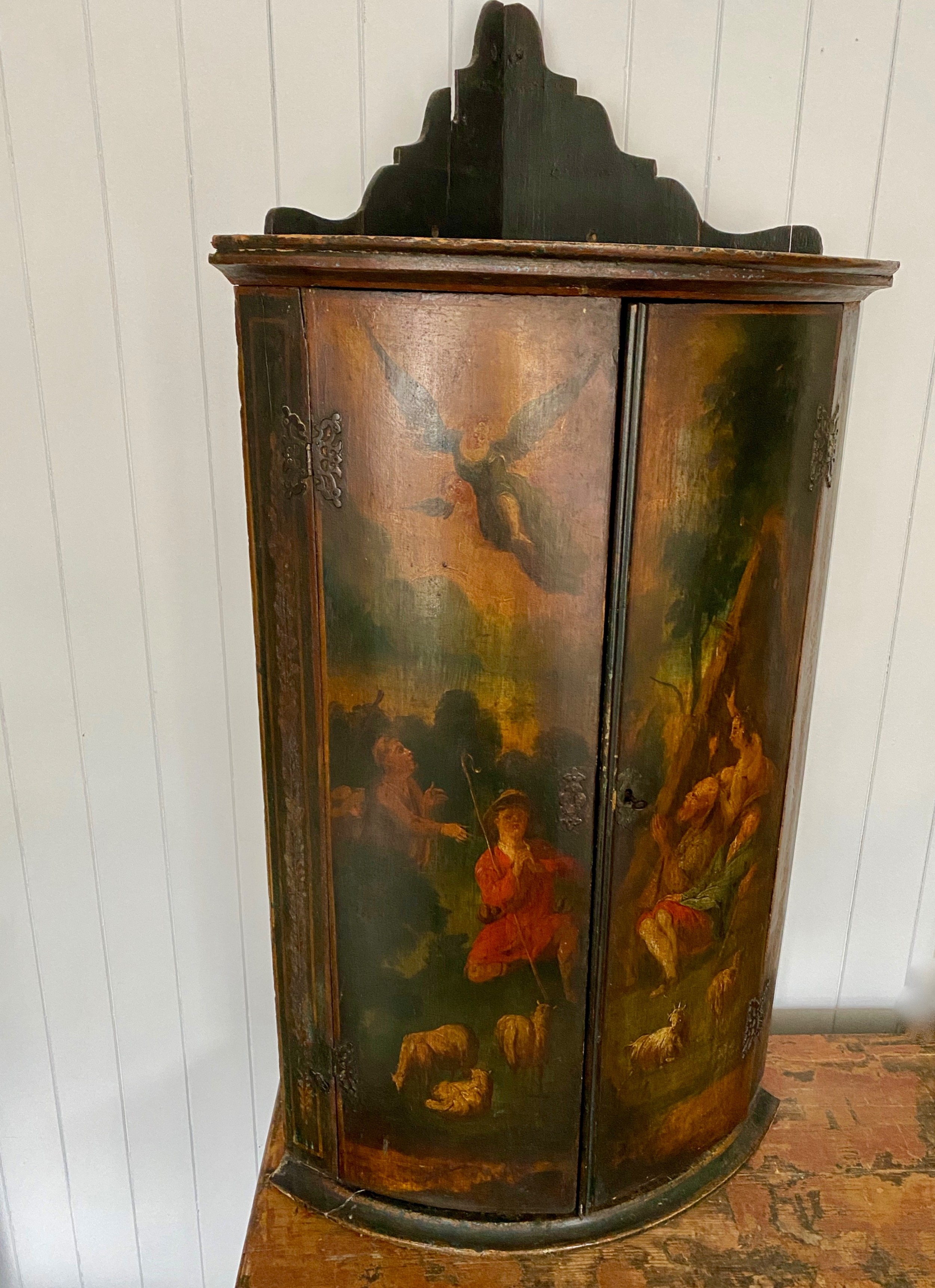 a georgian painted bow front corner cupboard