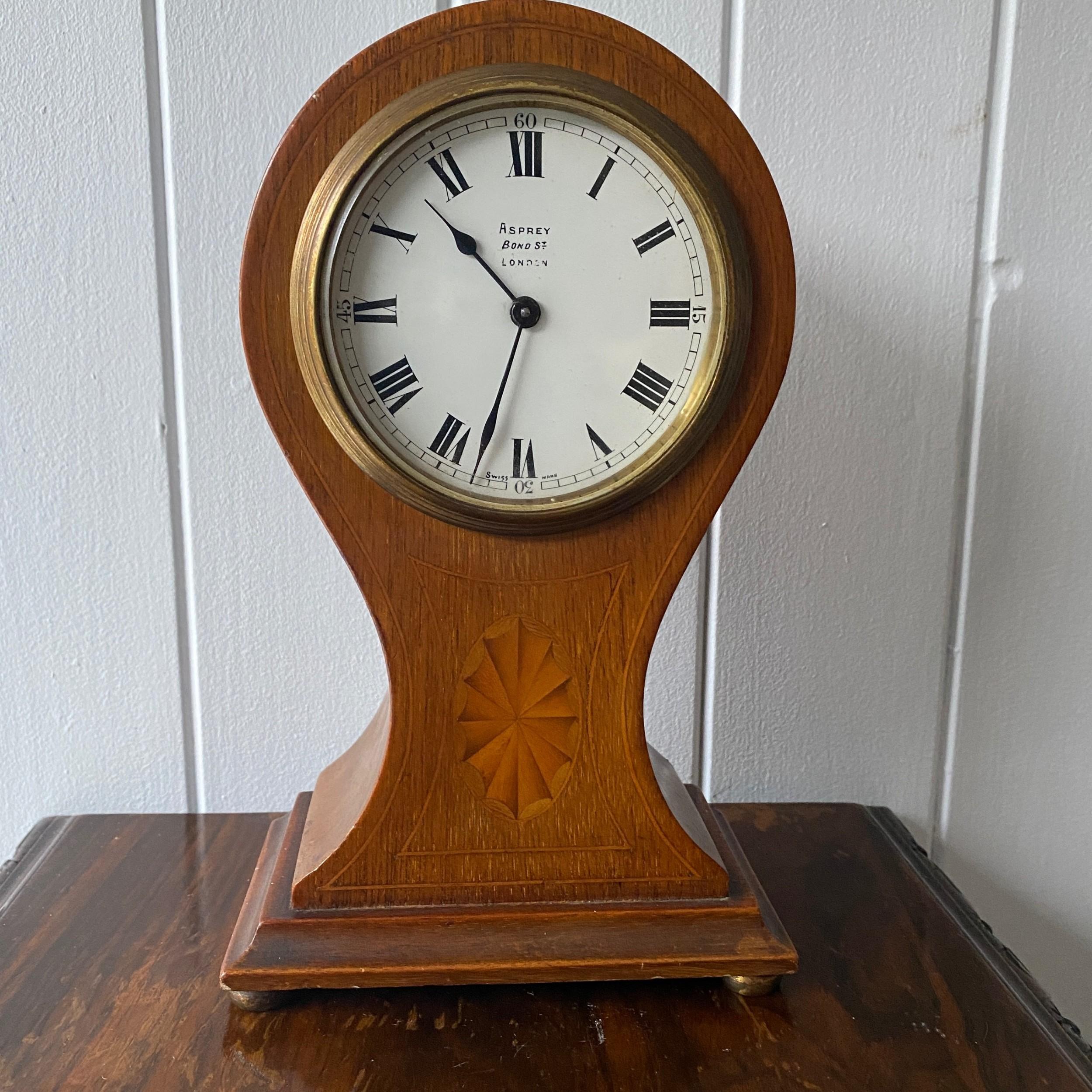 an edwardian inlaid mahogany balloonshape mantel clock by asprey london