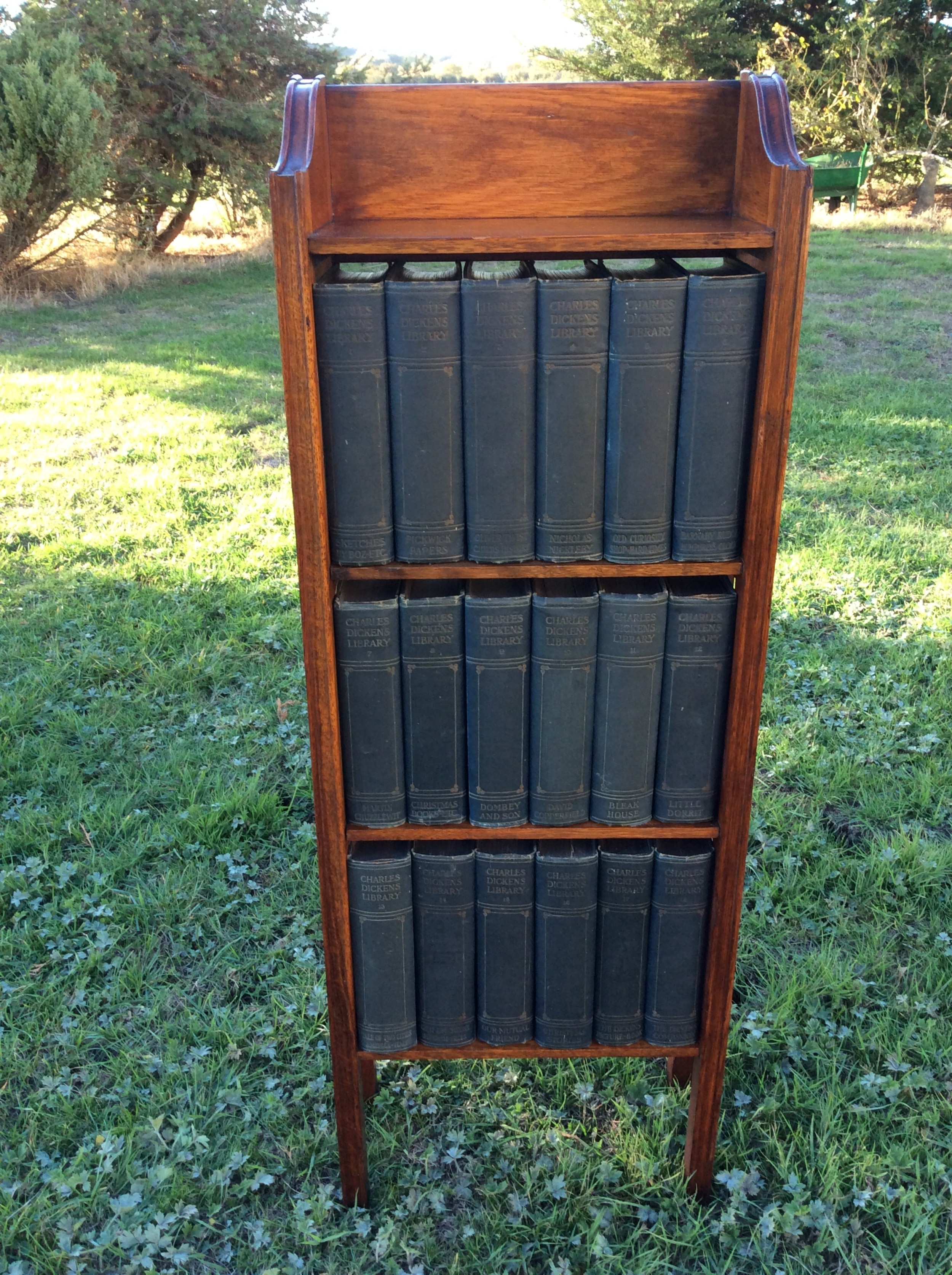 oak open bookcase complete with set of charles dickens novels