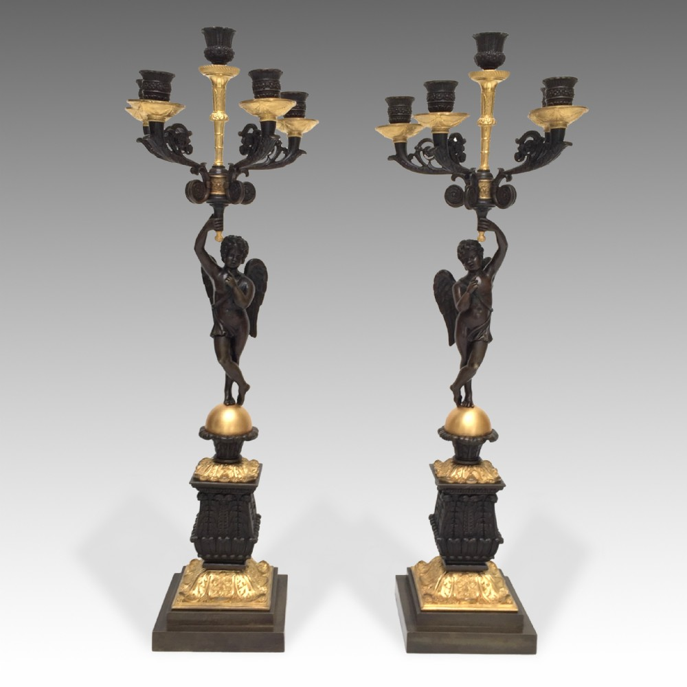 a pair of 19th century french restauration period gilt patinated bronze candelabra
