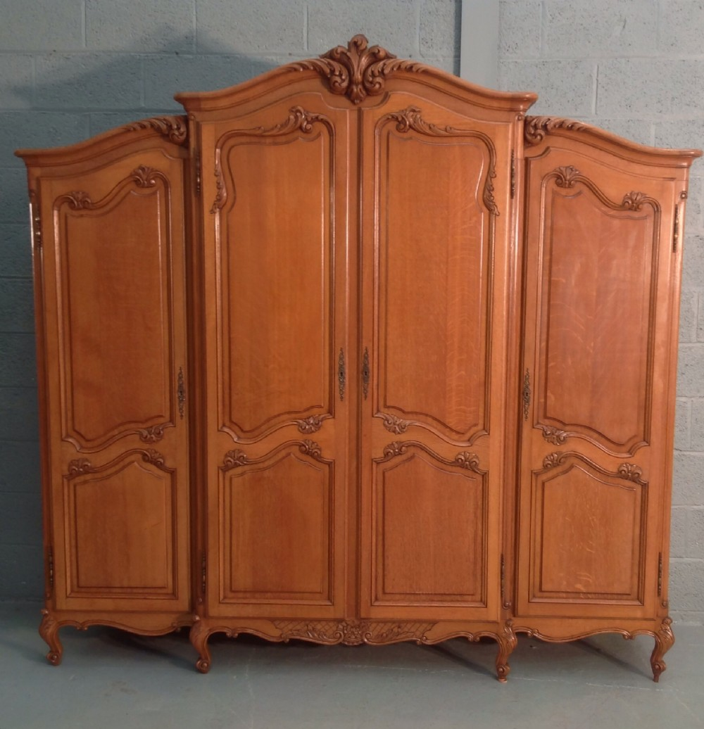 large breakfront carved 4 door oak armoire 335025