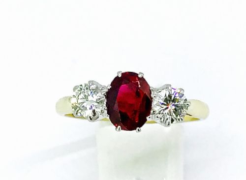 a traditional three stone ruby and diamond ring