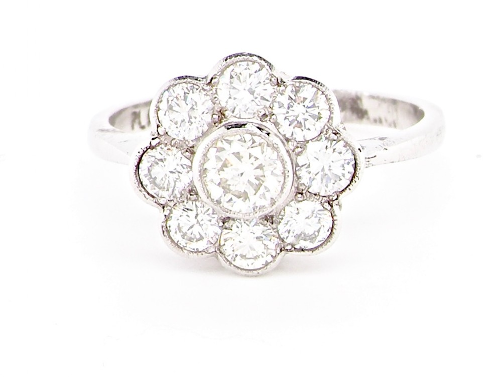 a vintage daisy cluster diamond ring