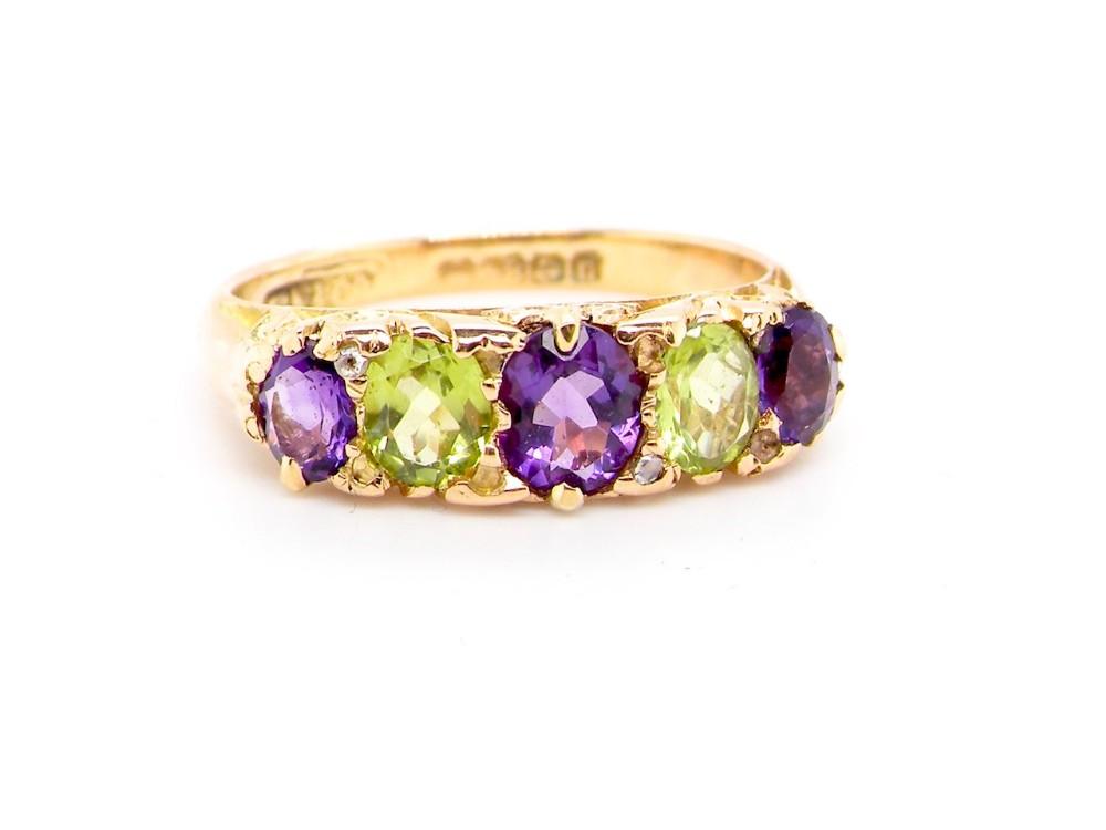 an 18 carat gold amethyst and peridot dress ring