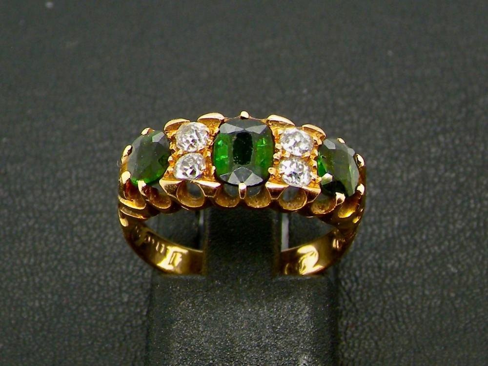 an antique green tourmaline and diamond dress ring